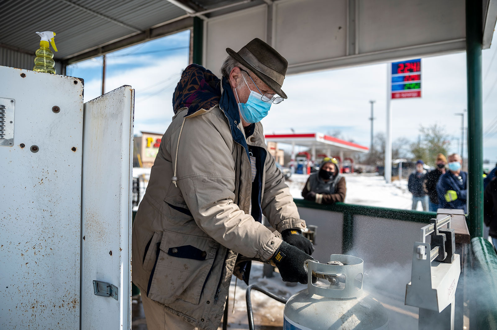 A man fills a propane tank in Austin, Texas, on Tuesday, February 16.