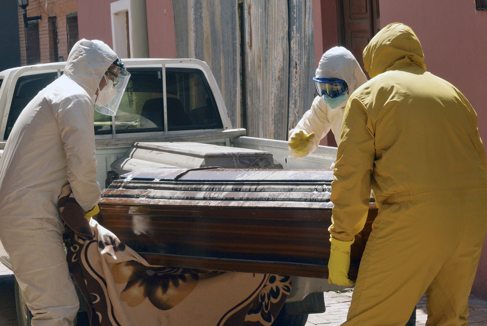 Health workers carry the coffin of a Covid-19 victim from the San Jose nursing home in Cochabamba, Bolivia, on July 20.