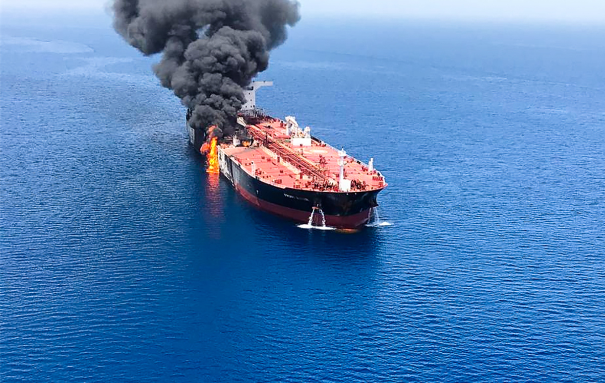 A picture obtained by AFP from Iranian News Agency ISNA on June 13, 2019 reportedly shows fire and smoke billowing from Norwegian owned Front Altair tanker said to have been attacked in the waters of the Gulf of Oman.