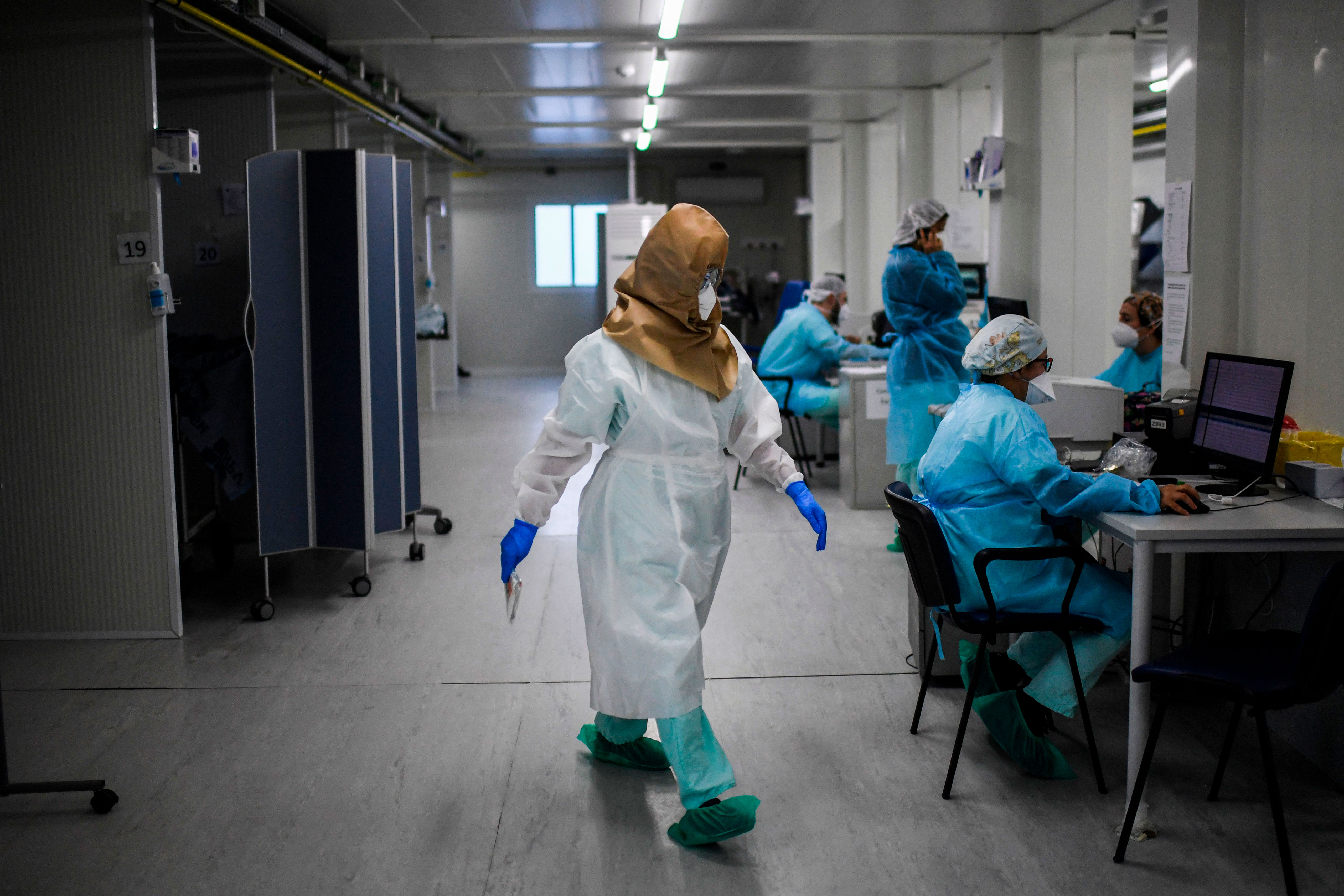 A health care worker walks in the Covid-19 emergency room at Santa Maria hospital in Lisbon, Portugal, on January 11.