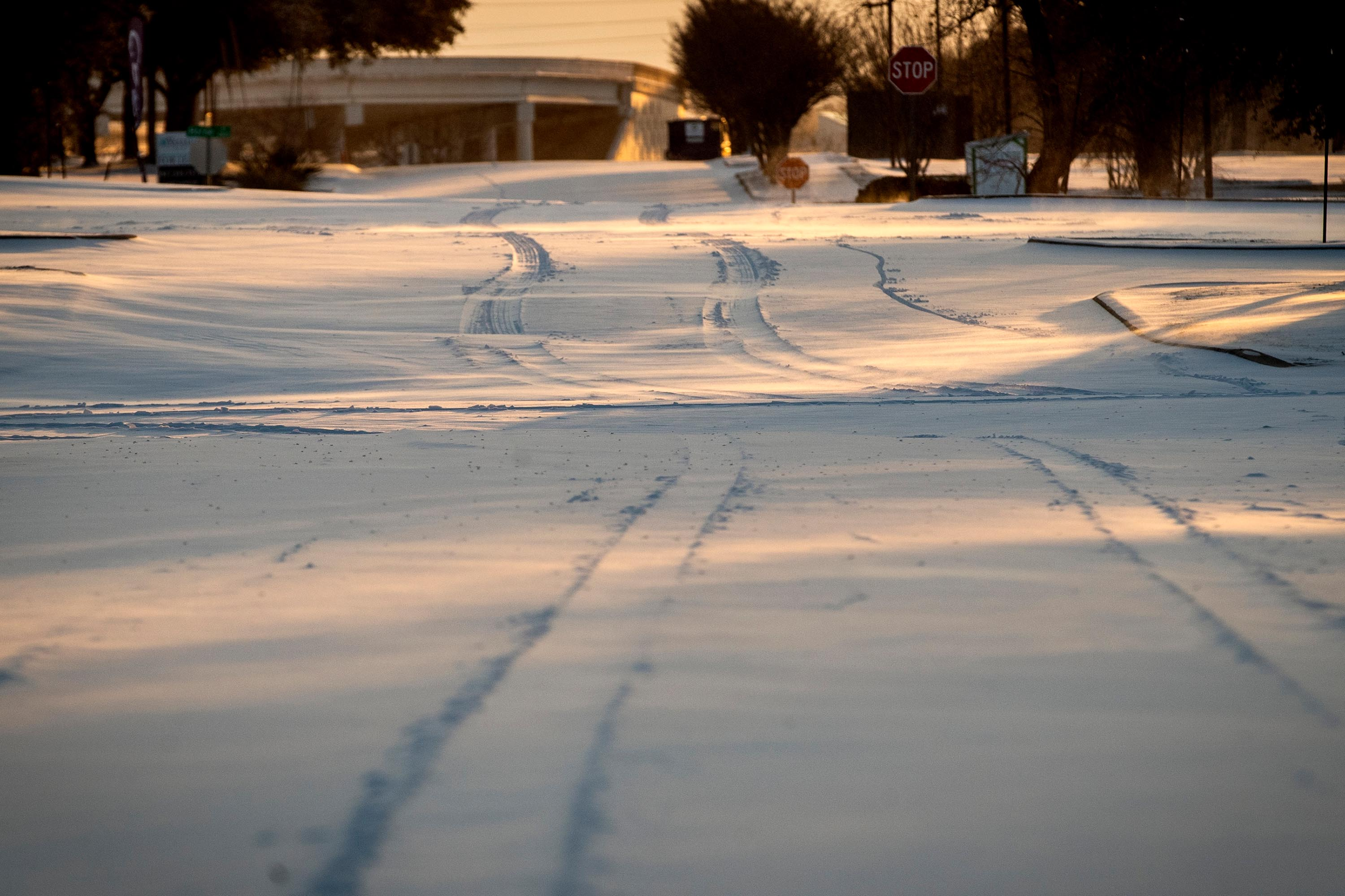 Snow covers the streets after a storm Monday, February 15, in Fort Worth, Texas.