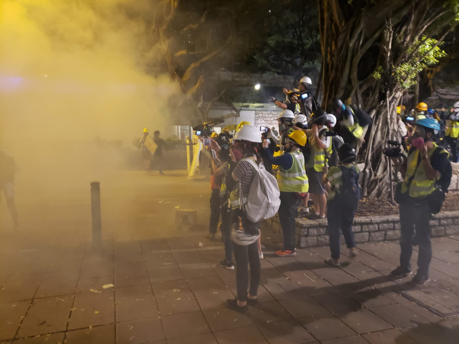 Tear gas is fired at protesters surging forward. Ben Westcott/CNN