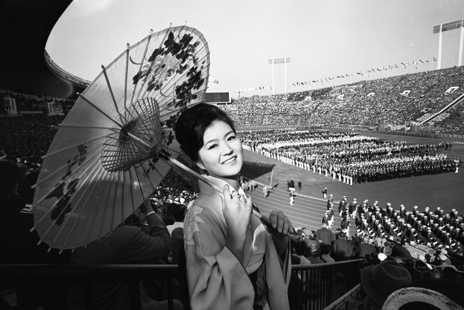 A woman wears traditional clothing at the opening ceremony on October 10, 1964.