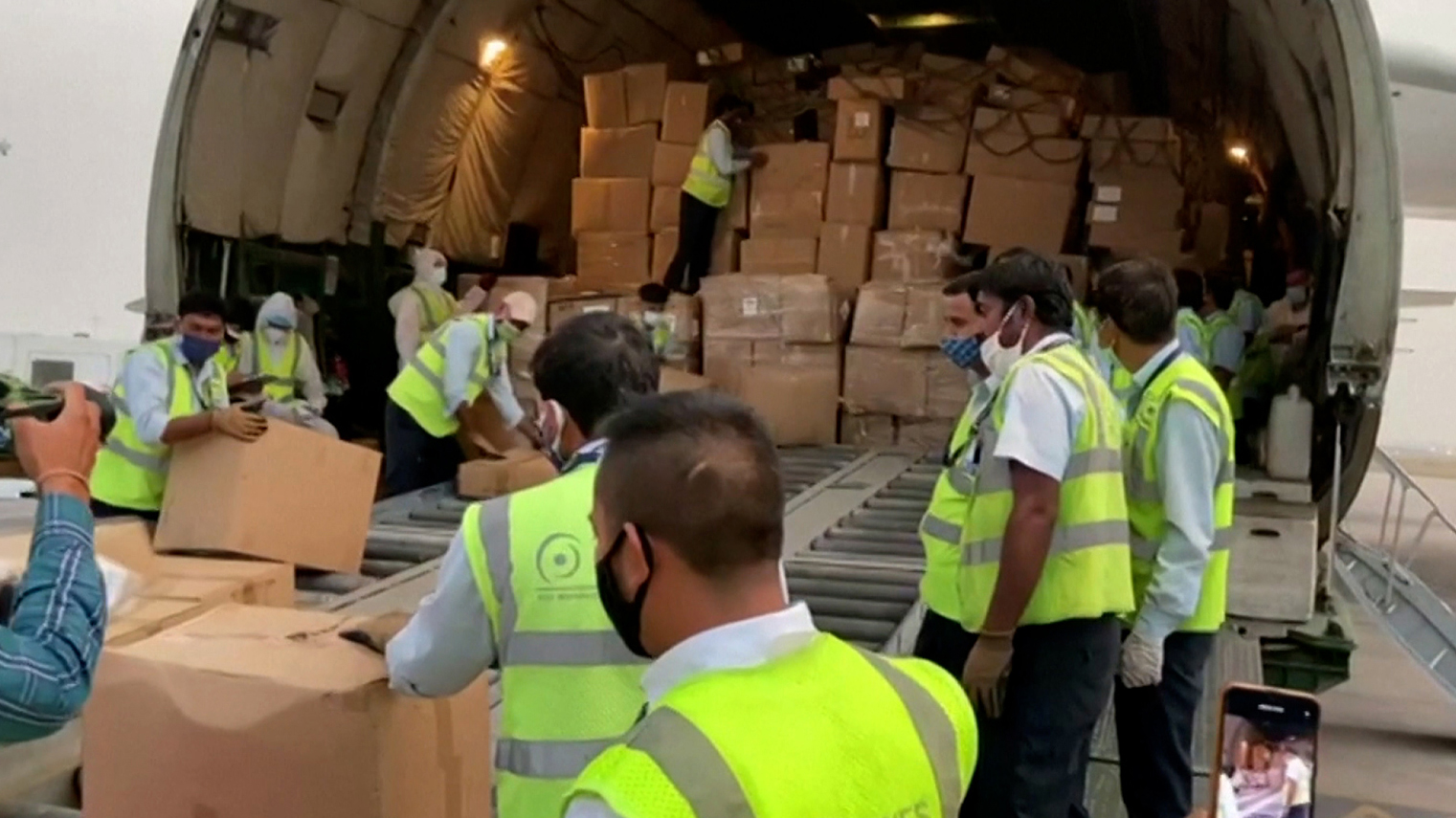 An aircraft carrying medical supplies for India is unloaded in New Delhi, on April 29.