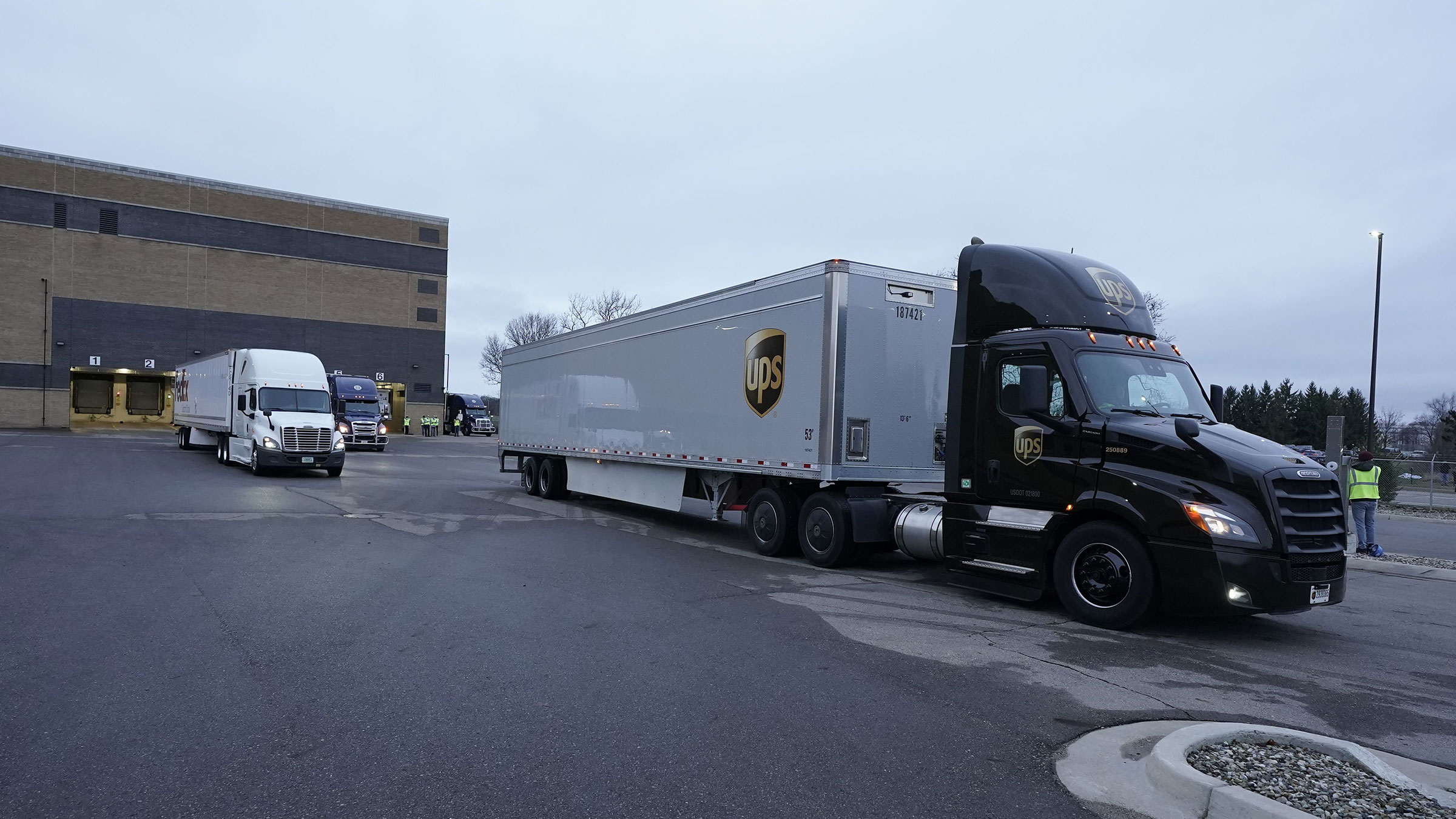 Trucks containing the Pfizer-BioNTech Covid-19 vaccine leave the Pfizer manufacturing plant in Kalamazoo, Michigan, on December 13.