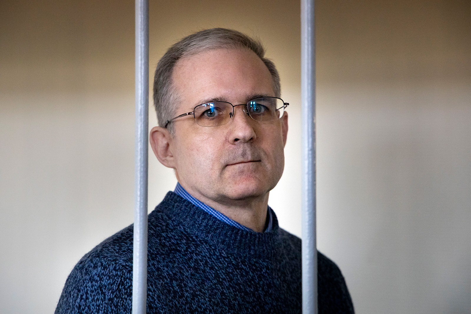 Paul Whelan stands in a holding cell as he waits for a hearing in a court room in Moscow, Russia, on August 23, 2019.
