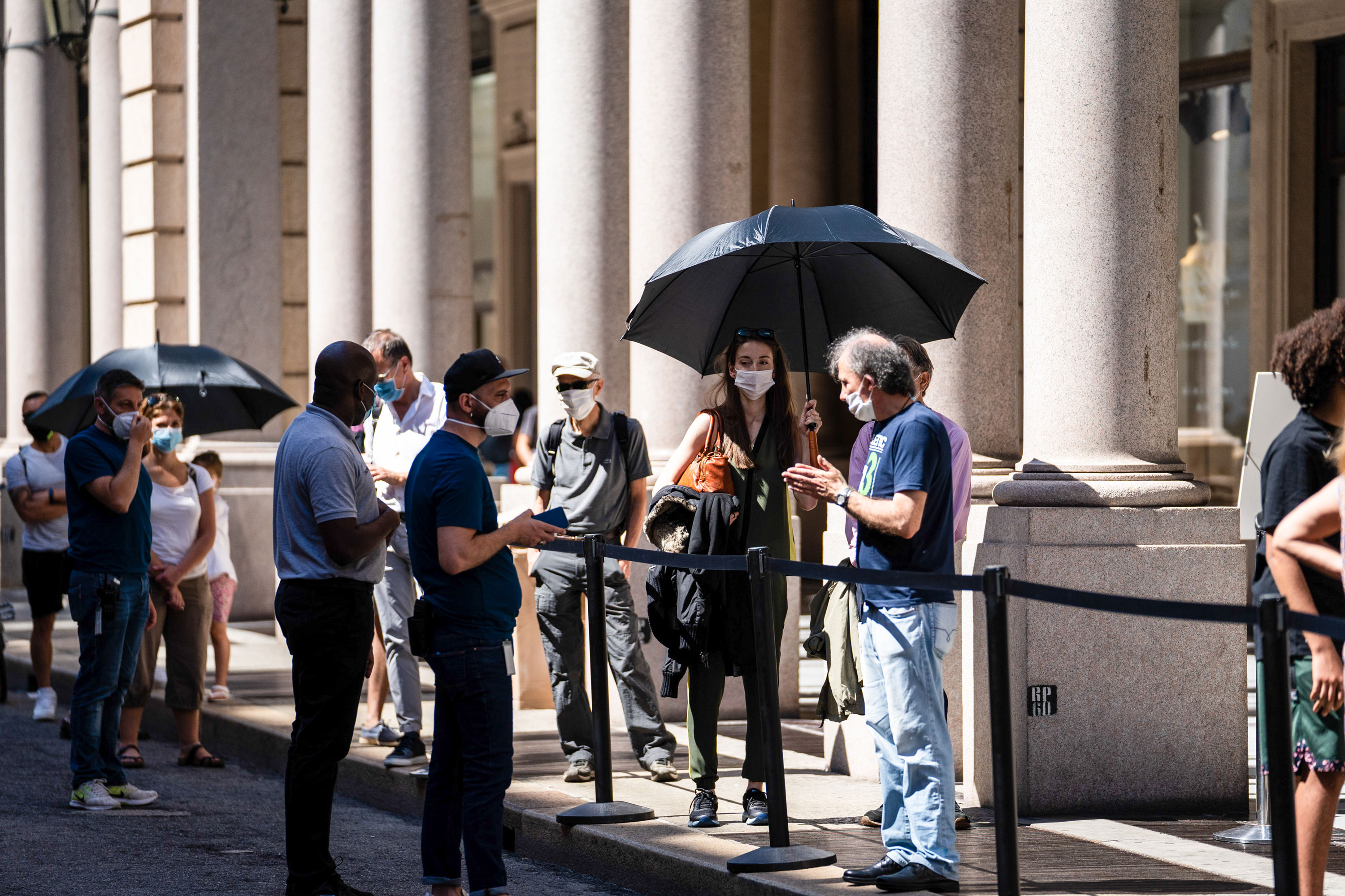 Pedestrians adopt a safe social distance as they stand in line outside an Apple Inc. store in Turin, Italy, on June 23.