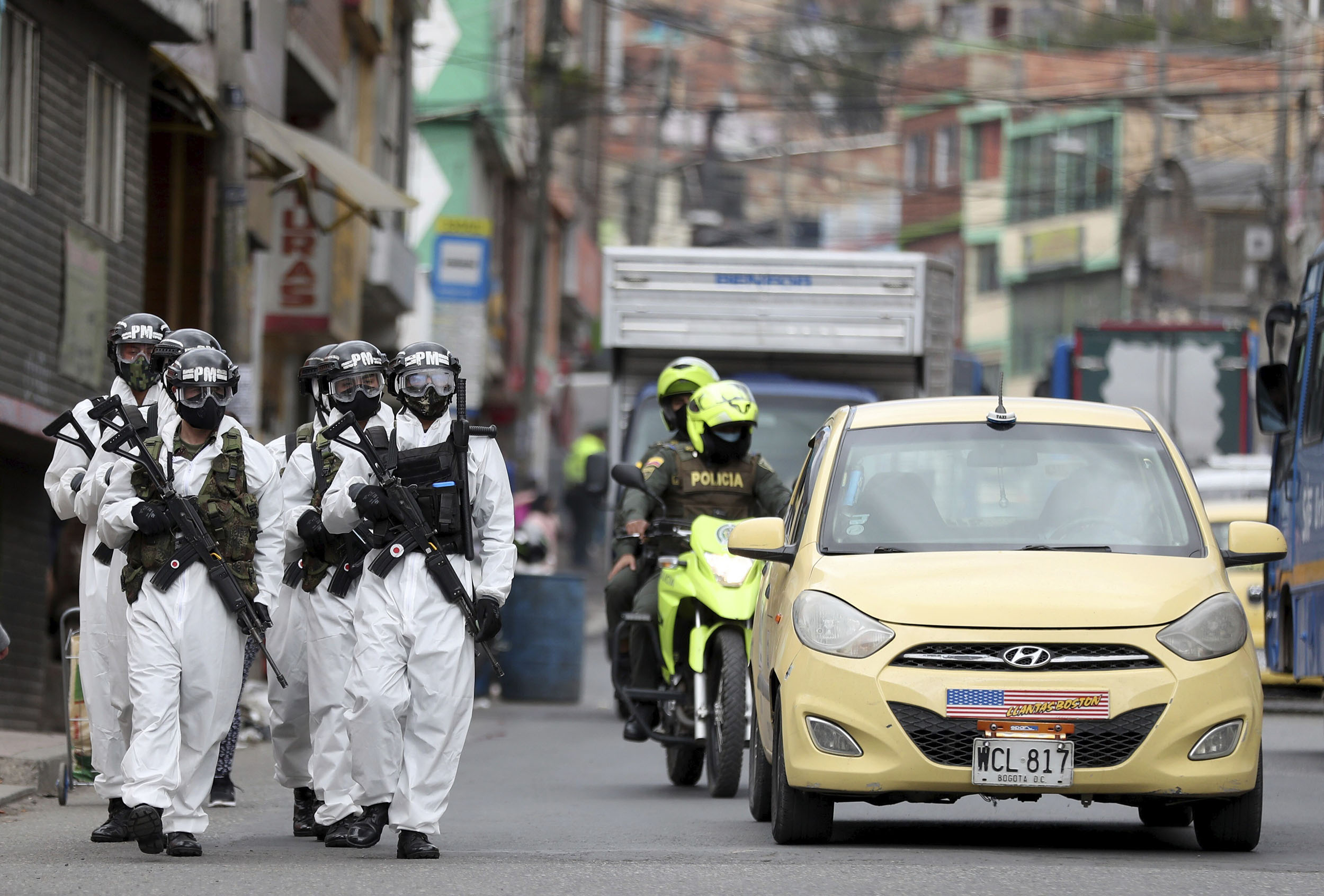 Soldiers patrol a neighborhood in Bogota, Colombia, on July 13.