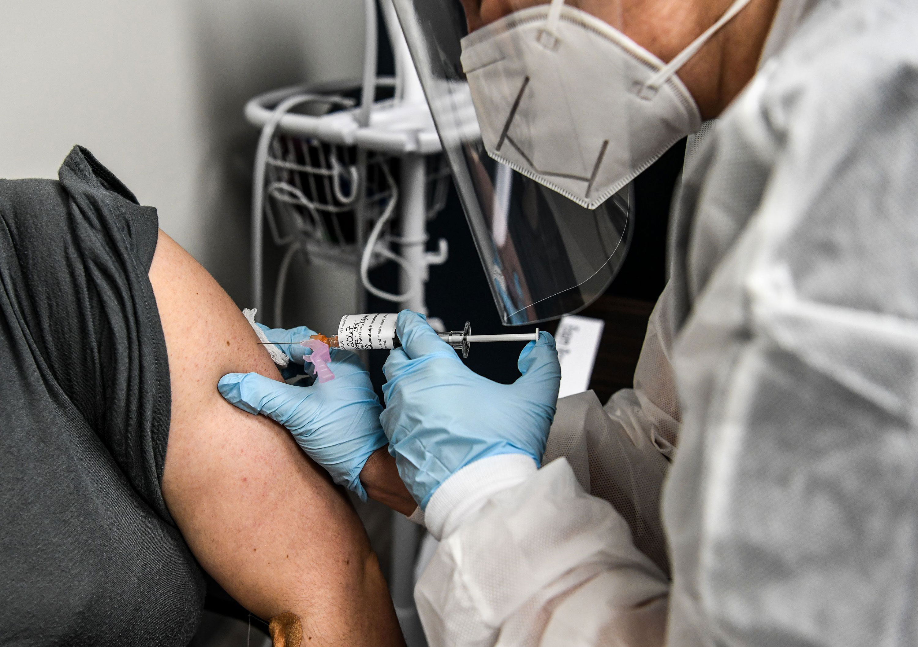 A patient receives a coronavirus vaccine as part of a study at the Research Centers of America on August 13 in Hollywood, Florida.