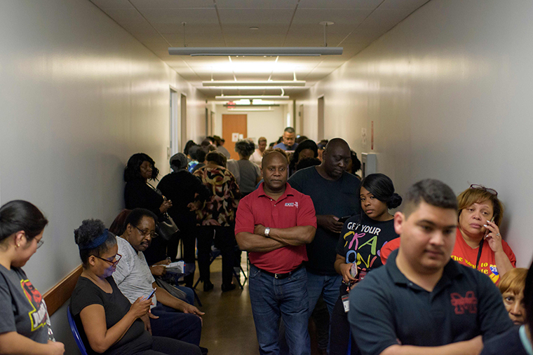 Voters line up at a polling station to cast their ballots during the presidential primary in Houston, Texas on Tuesday, March 3.