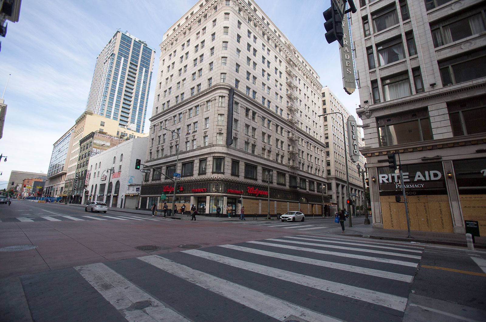 A nearly empty street corner in downtown Los Angeles on Sunday, May 31.