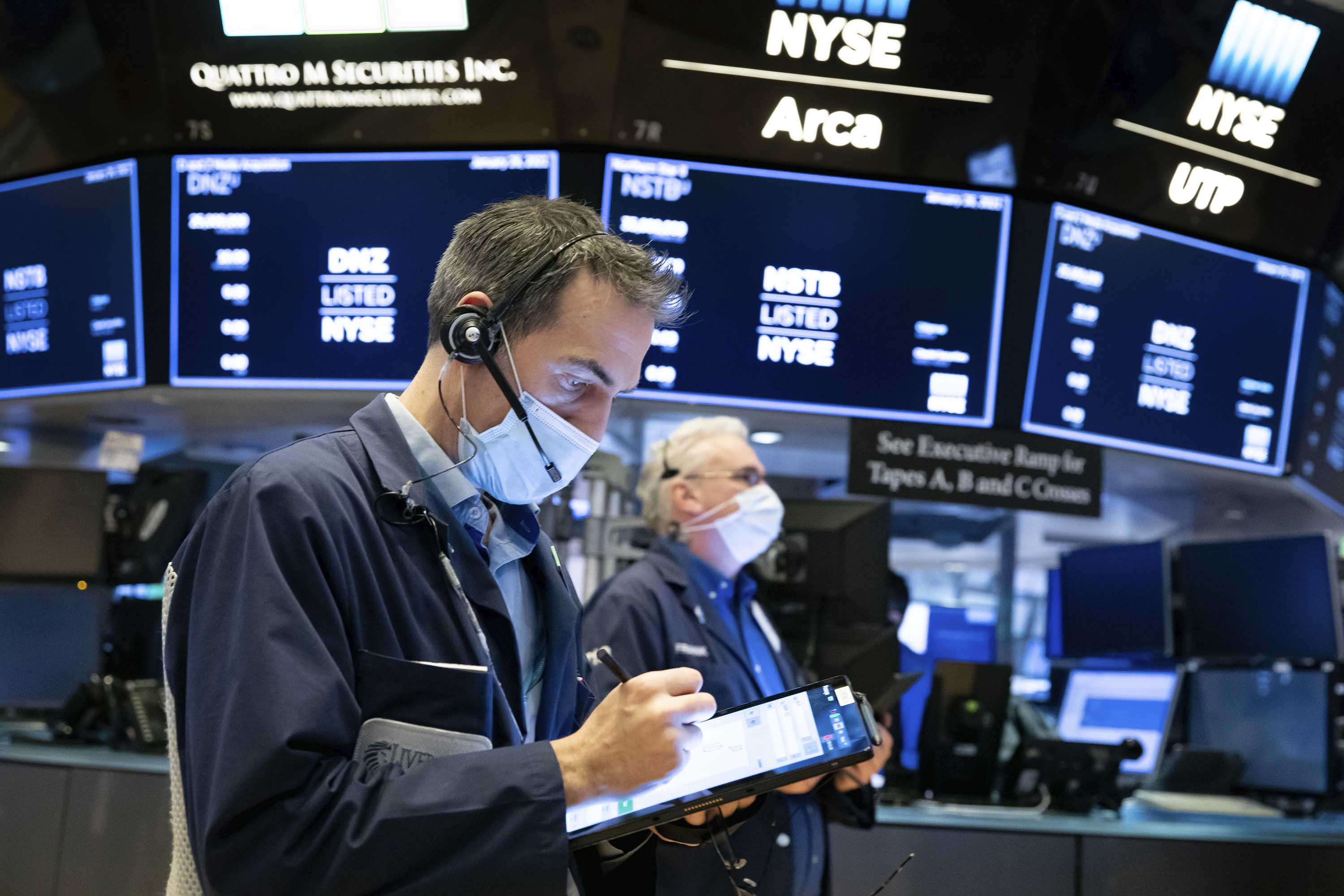 Traders work on the floor of the New York Stock Exchange on Tuesday, January 26.