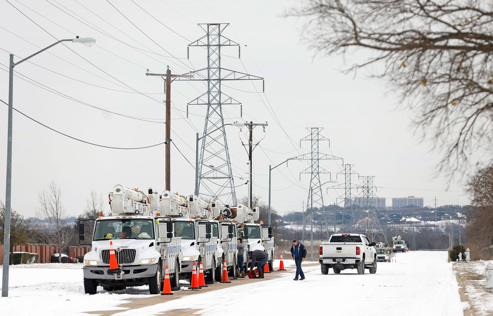 Pike Electric service trucks line up in Fort Worth, Texas, on February 16.
