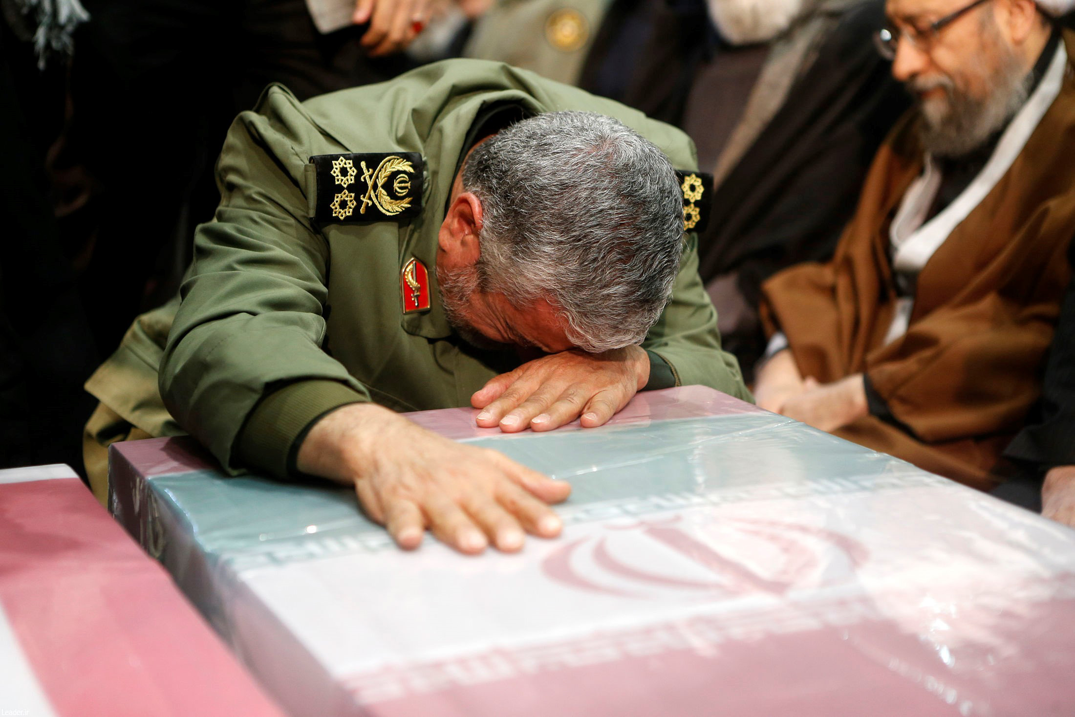 General Ismail Qaani -- Soleimani's long-time lieutenant and his successor as the leader of Iran's Islamic Revolutionary Guards' Quds Force -- cries over Soleimani's coffin during the funeral ceremony on Monday.