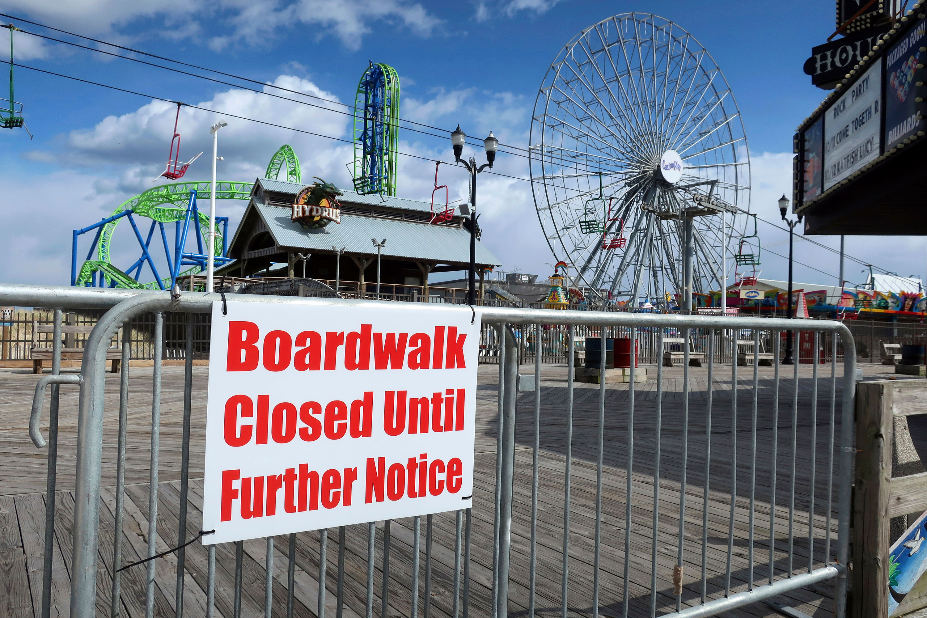 A sign informs visitors that the boardwalk at Seaside Heights in New Jersey is closed on April 10.