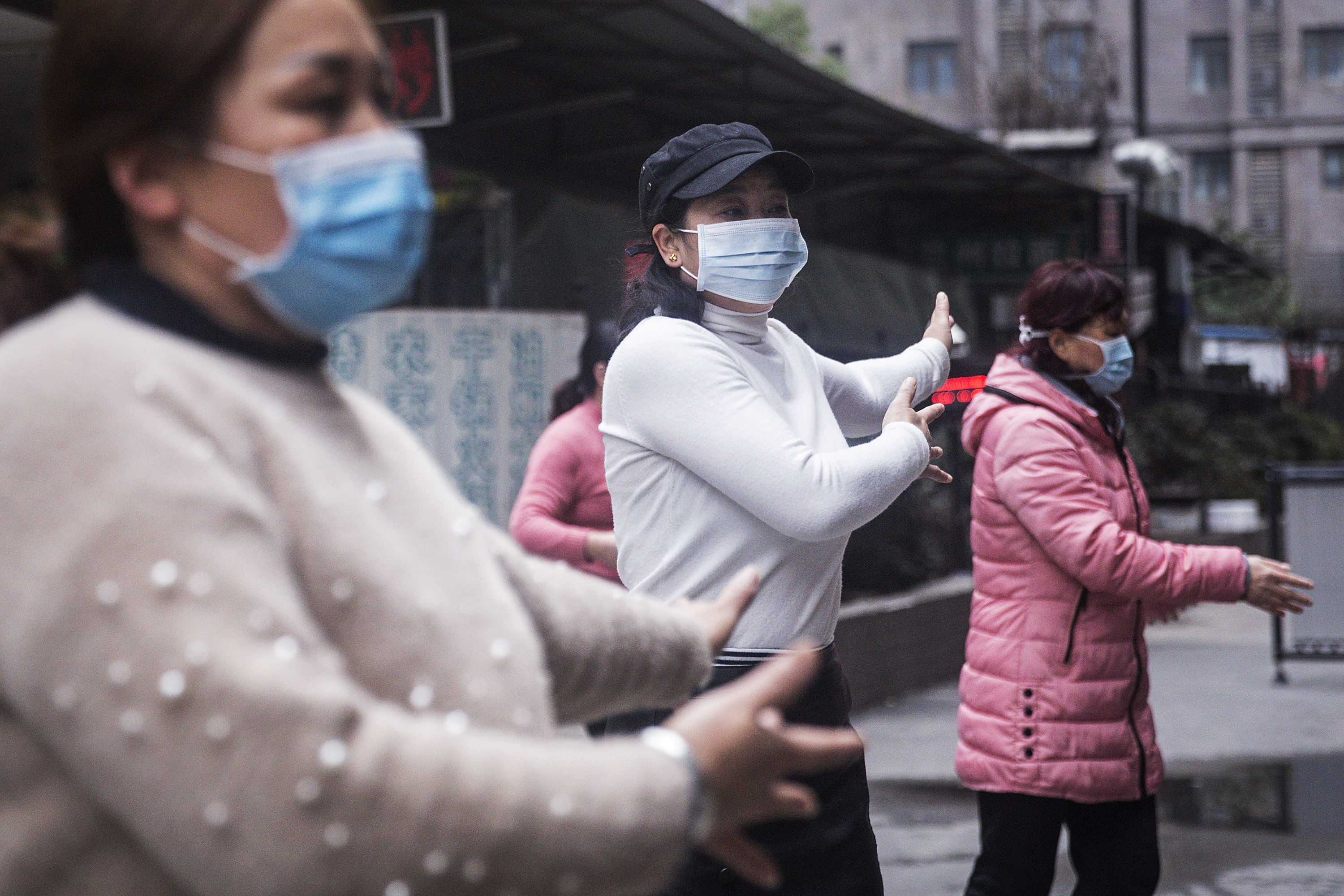 A group of women wear masks while exercising on January 27, 2020 in Wuhan, China.