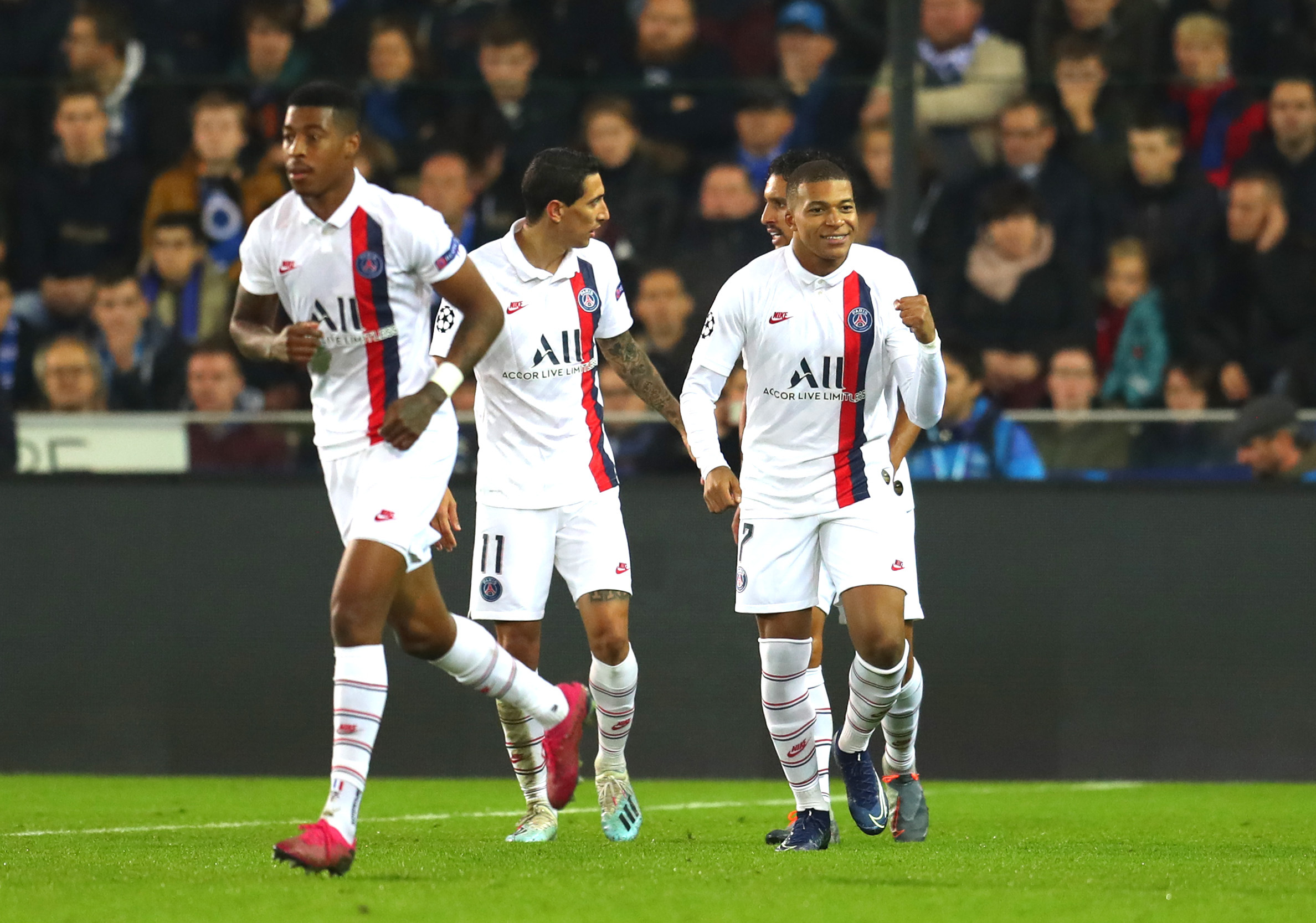Kylian Mbappe of Paris Saint-Germain celebrates with teammates after scoring his team's second goal