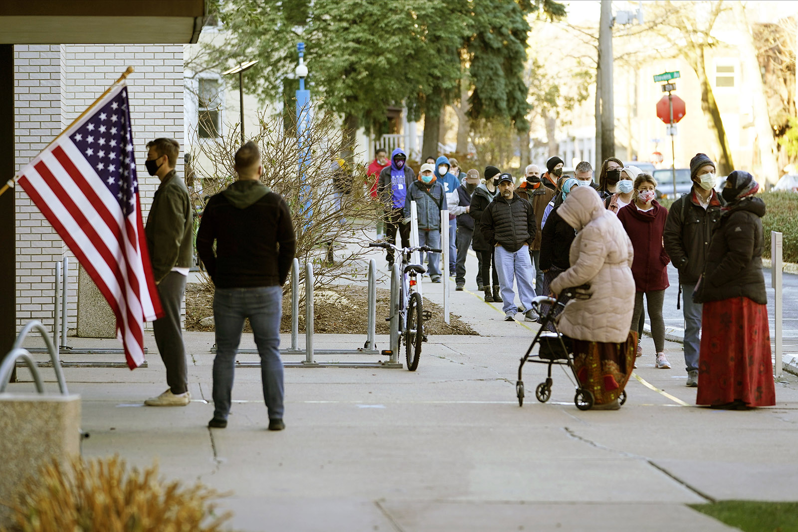 Voters waitto cast their votes on Election Day, Tuesday, Nov. 3, at the Minneapolis College of Art and Design in Minneapolis.