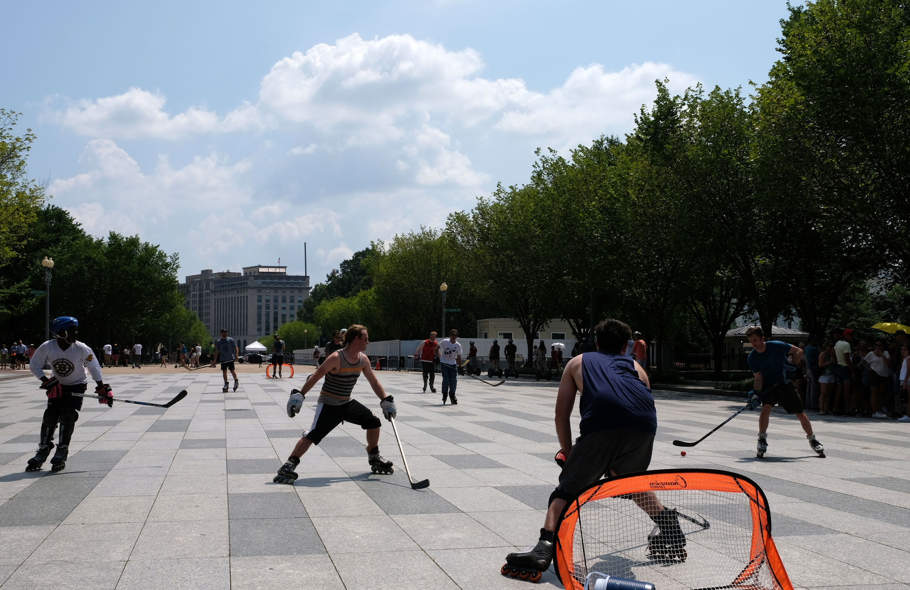 Street hockey players compete in a pick-up game near the White House during an excessive heat wave on July 20, 2019 in Washington, DC.