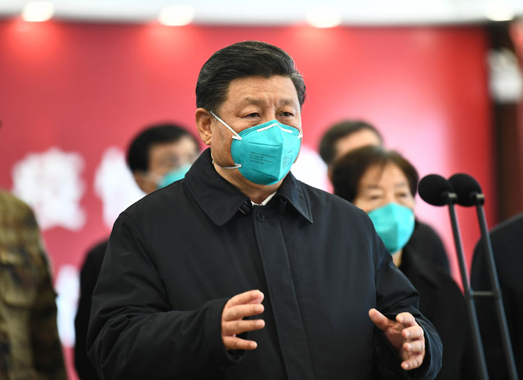 In this photo released by China's Xinhua news agency, Chinese President Xi Jinping talks by video with patients and medical workers at the Huoshenshan Hospital in Wuhan in central China's Hubei Province, Tuesday, March 10.