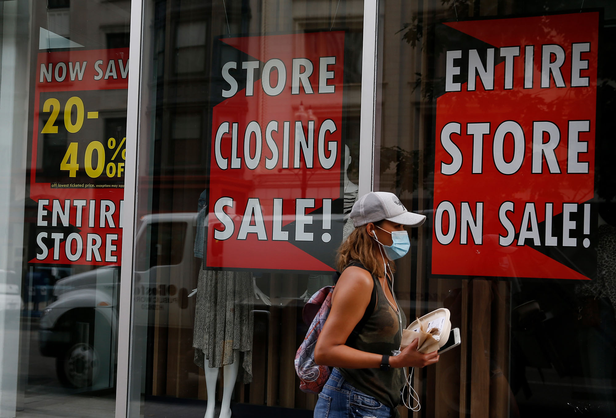 A person walks past a Lord & Taylor store in Bostonon August 4.