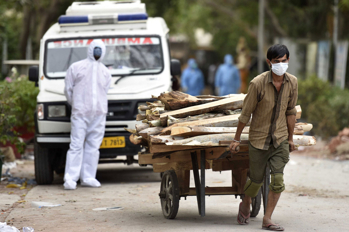 Wood is brought in for the cremation of Covid-19 victims at Sector 94 crematorium, on May 4 in Noida, India.