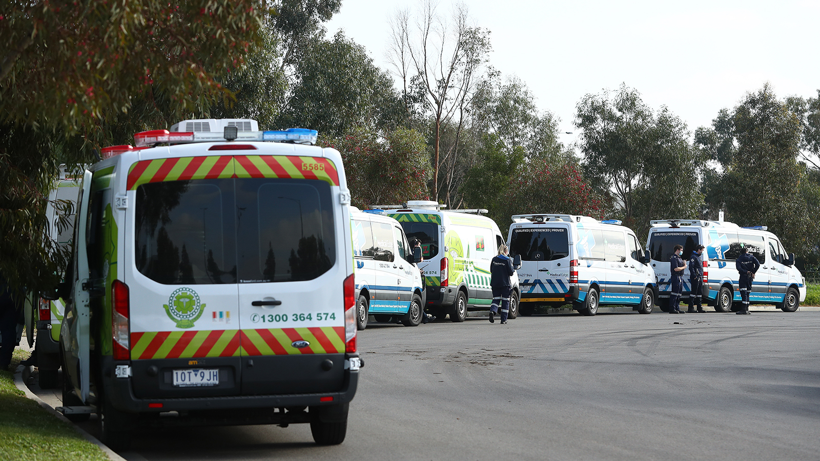 Ambulances are seen lined up the Epping Gardens Aged Care Home on July 29, in Melbourne.