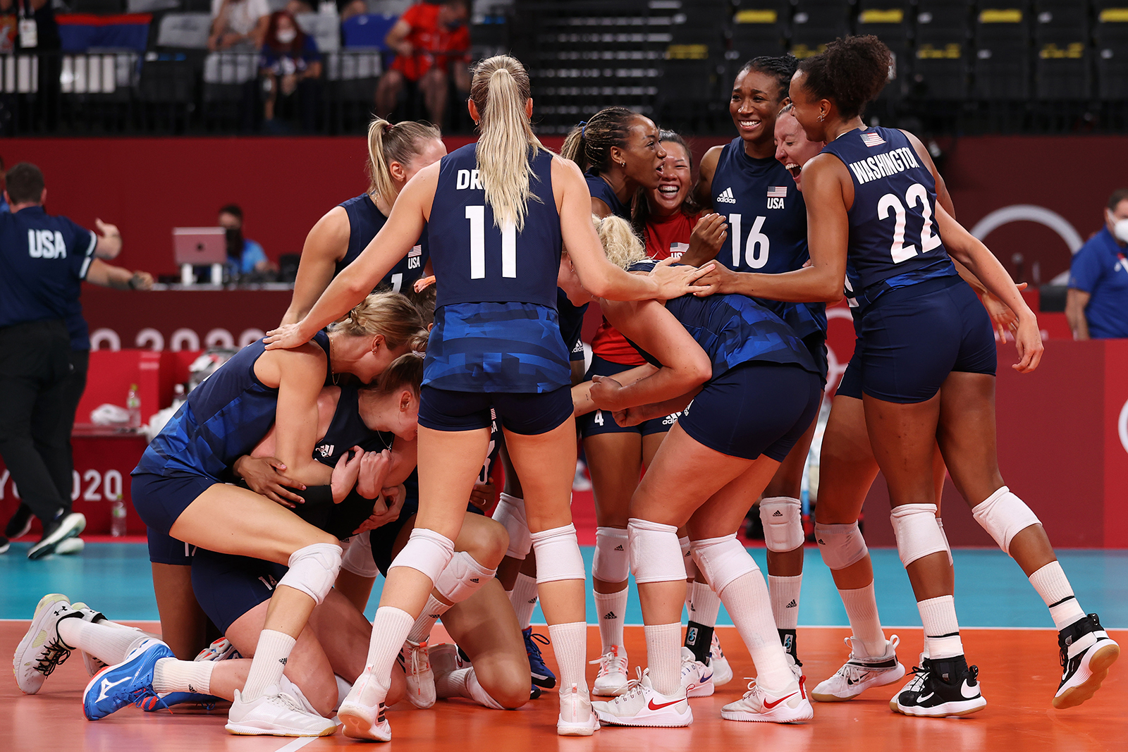 Team United States celebrates after defeating Team Serbia during their volleyball semifinal match on Friday.
