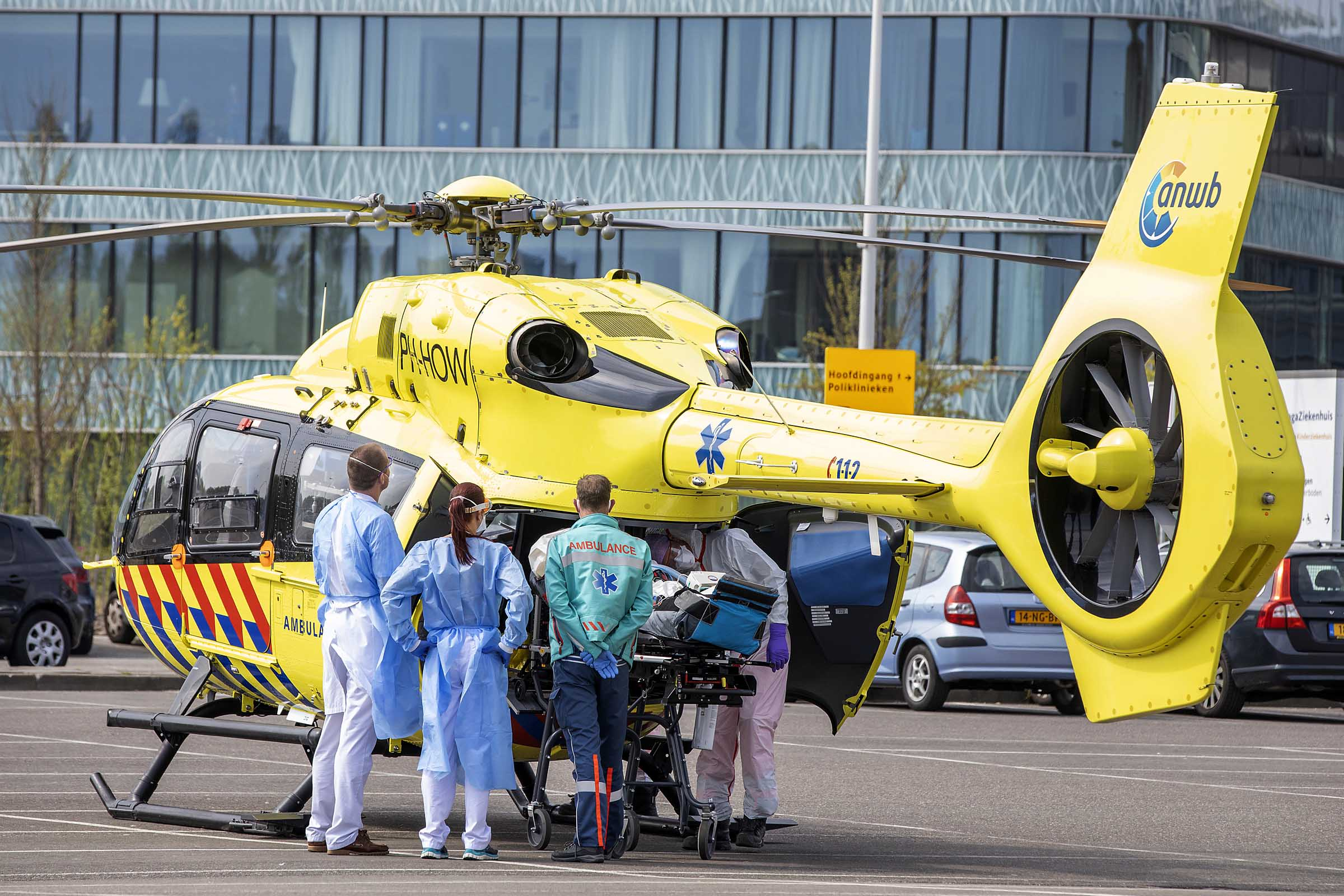 Medical workers are seen alongside a trauma helicopter as they transport a coronavirus patient on April 12 in Den Haag, Netherlands.