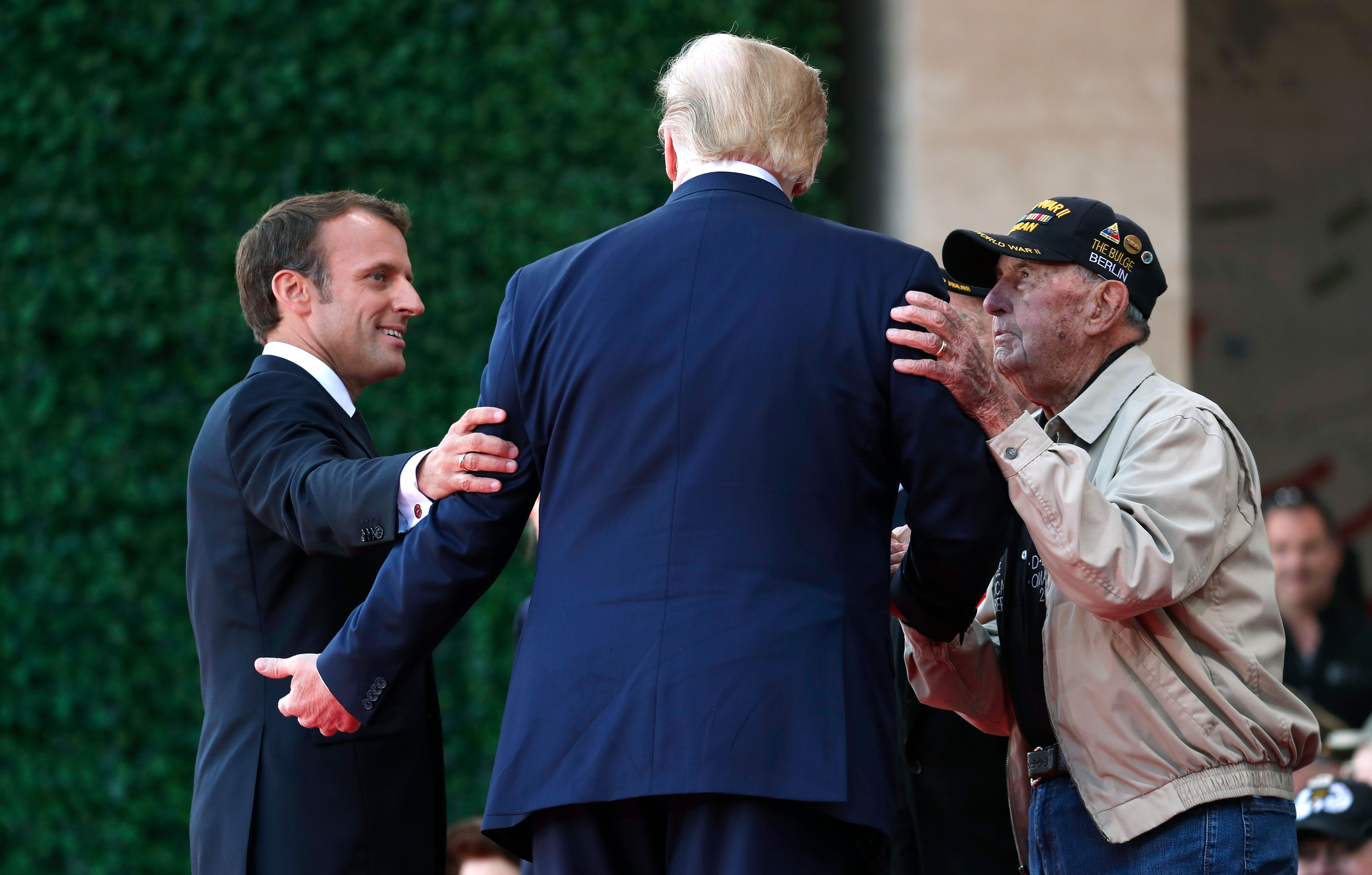 Macron and Trump greet a veteran.