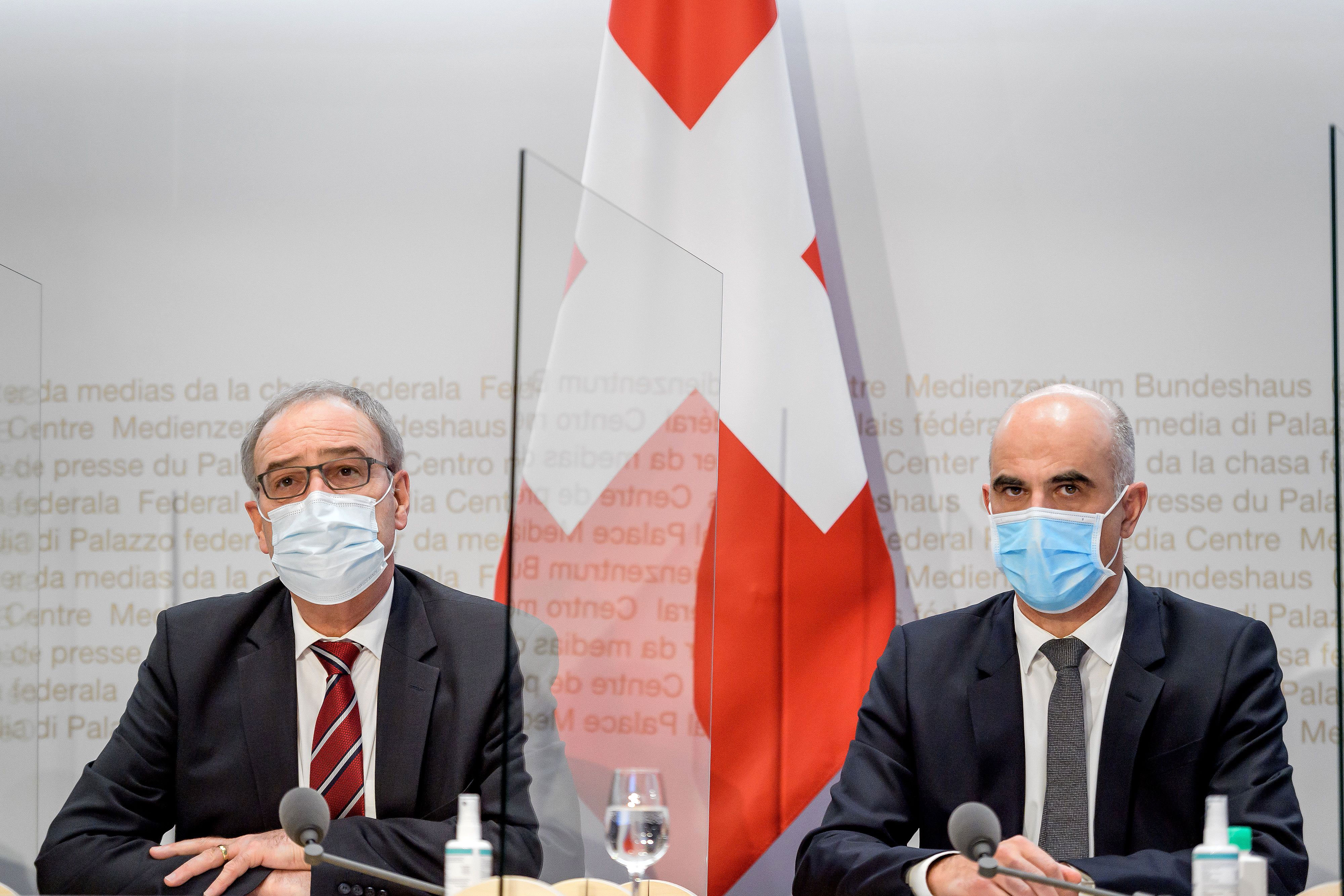 President of Switzerland Guy Parmelin, left, and Federal Councillor Alain Berset attend a press conference on January 13 in Bern, Switzerland.