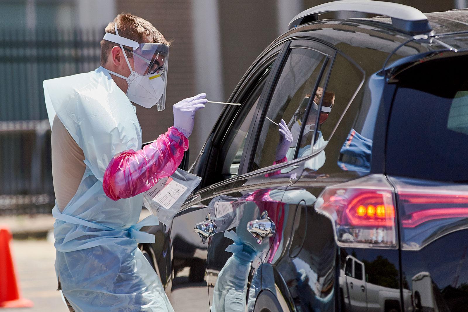 A nurse prepares to administer a coronavirus test in Omaha, Nebraska, on July 10.