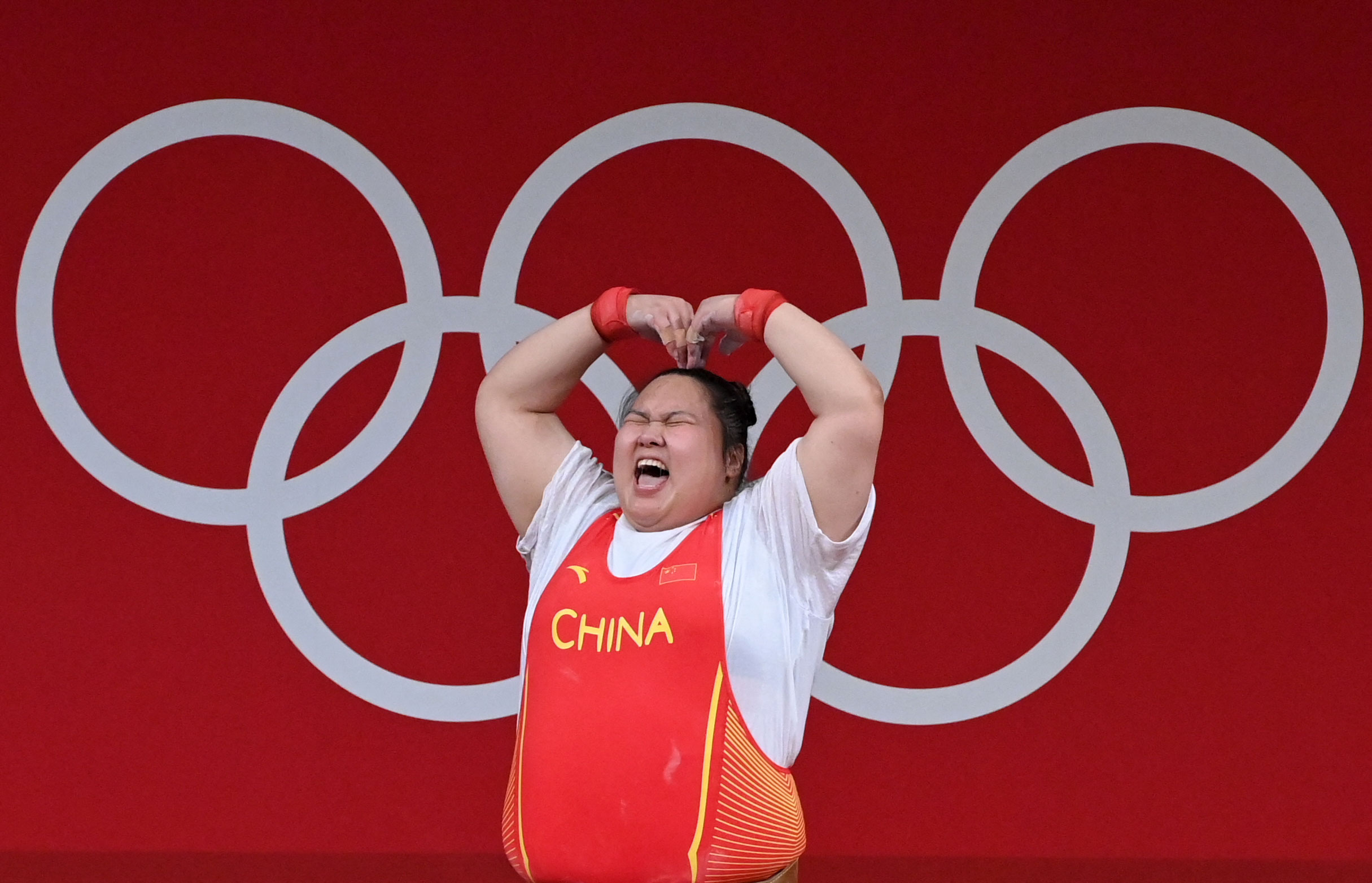 China's Li Wenwen celebrates during the +87-kilogram weightlifting event on August 2.