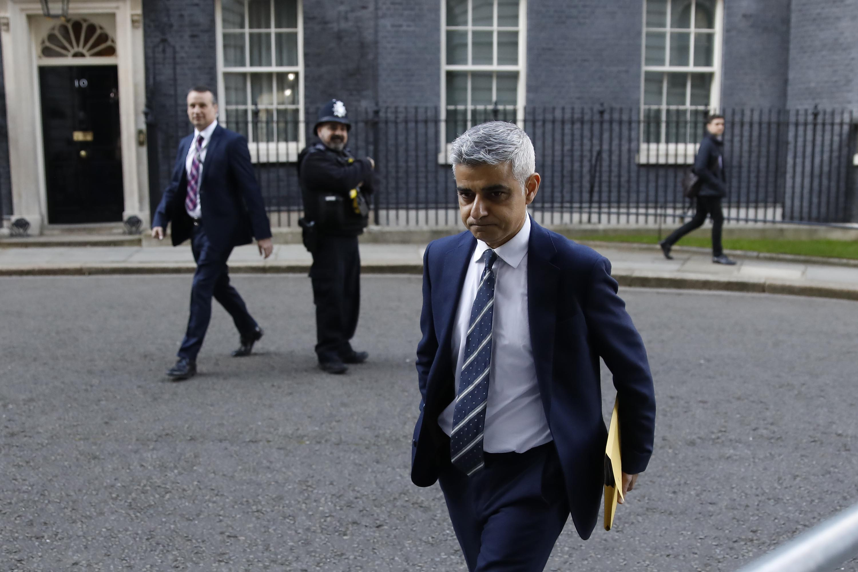 London Mayor Sadiq Khan leaves 10 Downing Street in London on March 16, after an emergency meeting on the UK government's response to the coronavirus outbreak.