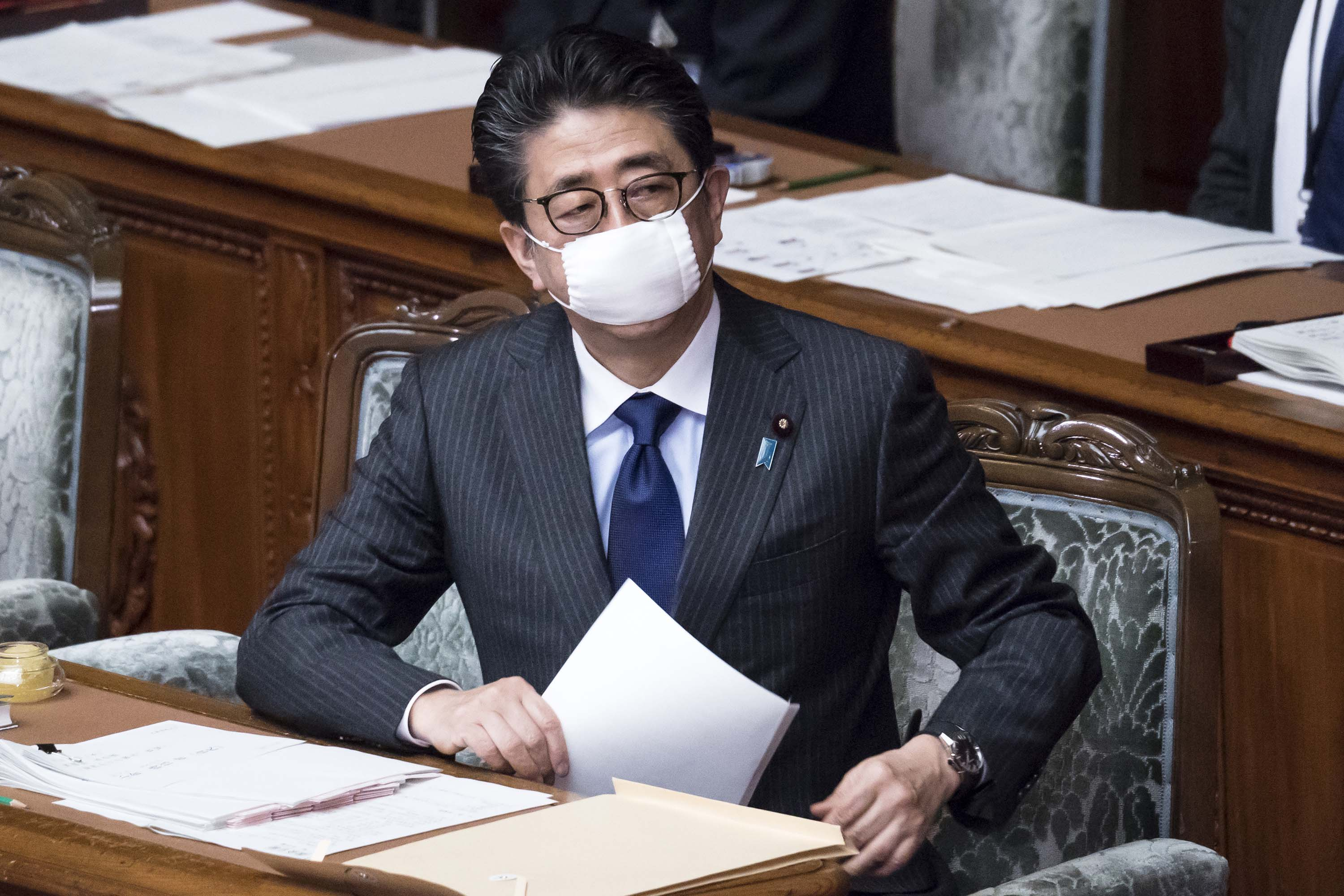 Japan's Prime Minister Shinzo Abe attends a parliamentary session on April 2 in Tokyo.