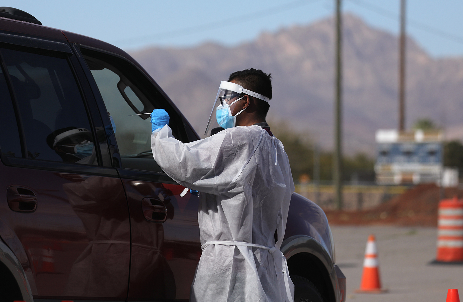 A frontline healthcare worker administers a swab test at a Covid-19 testing site amid a surge of coronavirus cases in El Paso, Texas, on November 13.