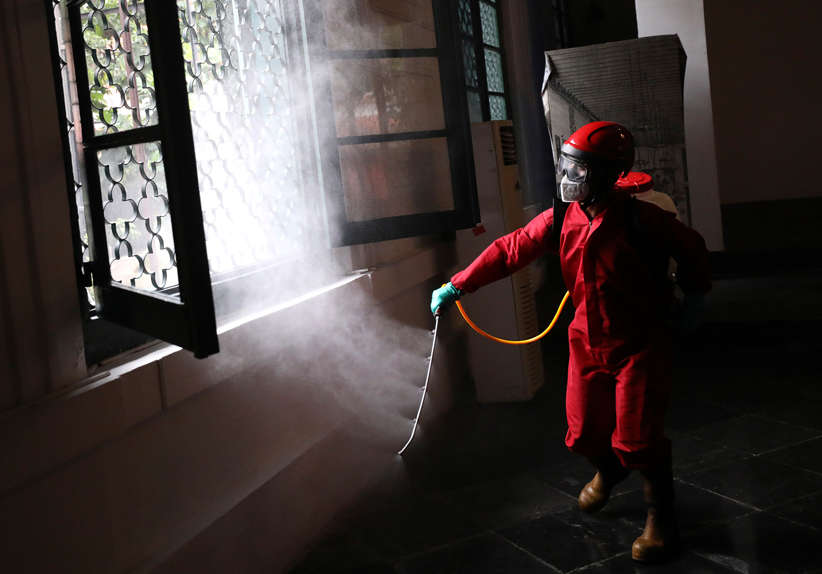 A firefighter sprays disinfectant at the Fine Arts and Ceramic Museum in Jakarta, Indonesia, on Monday, June 15.