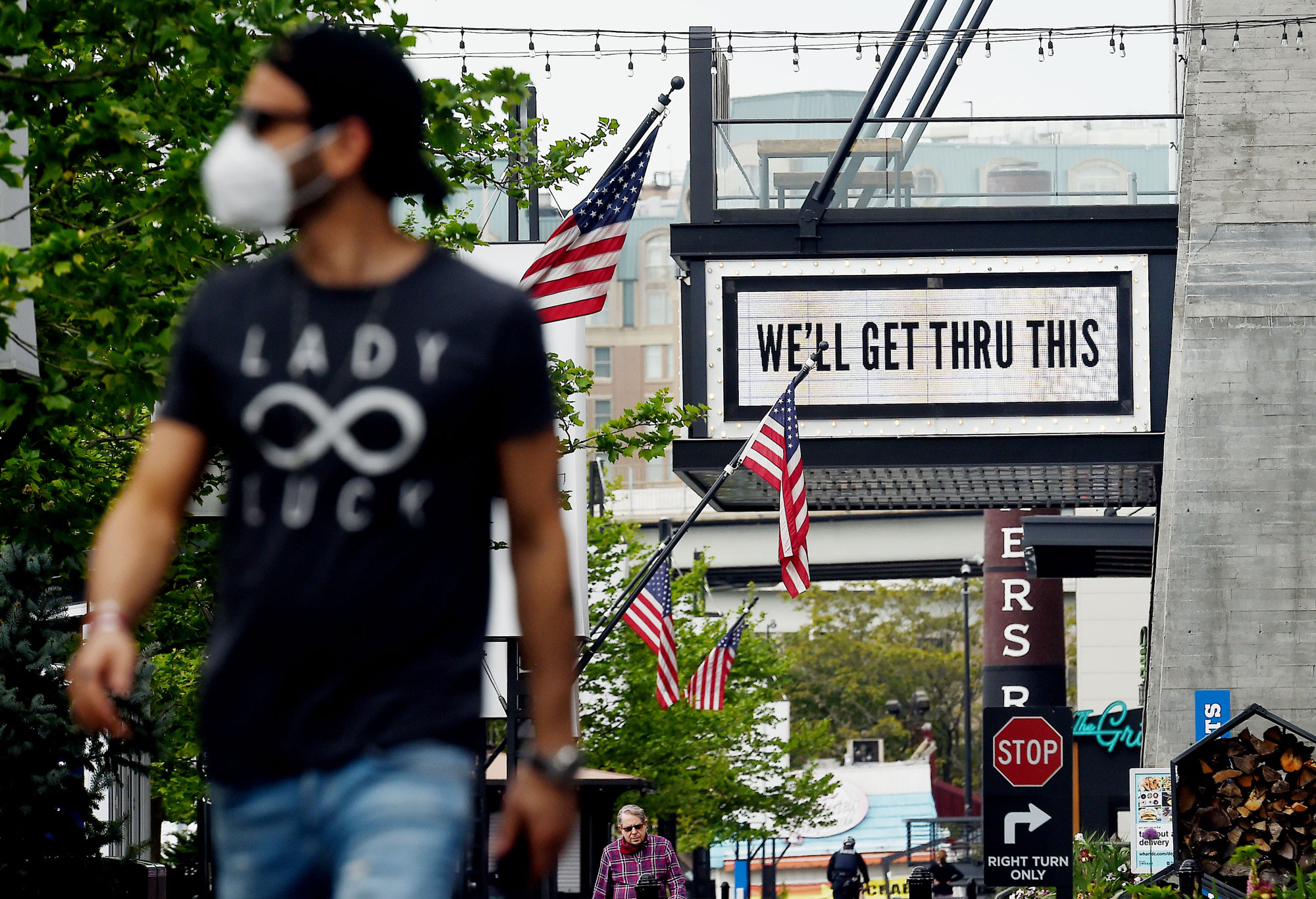 A man walks past a sign in front of the The Anthem on April 29 in Washington.
