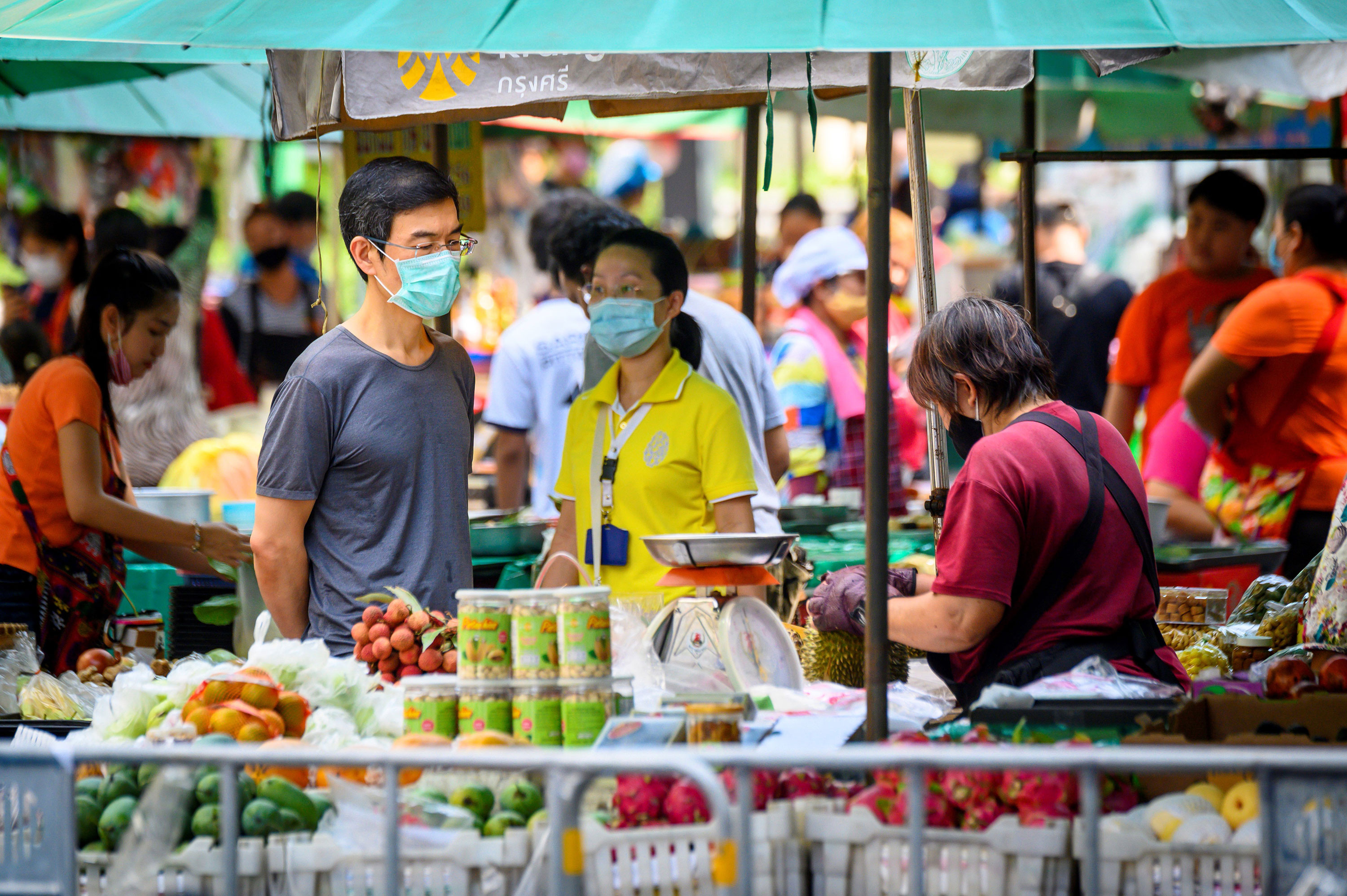 People shop at an open-air market outside Lumpini Park in Bangkok, Thailand, on May 3.