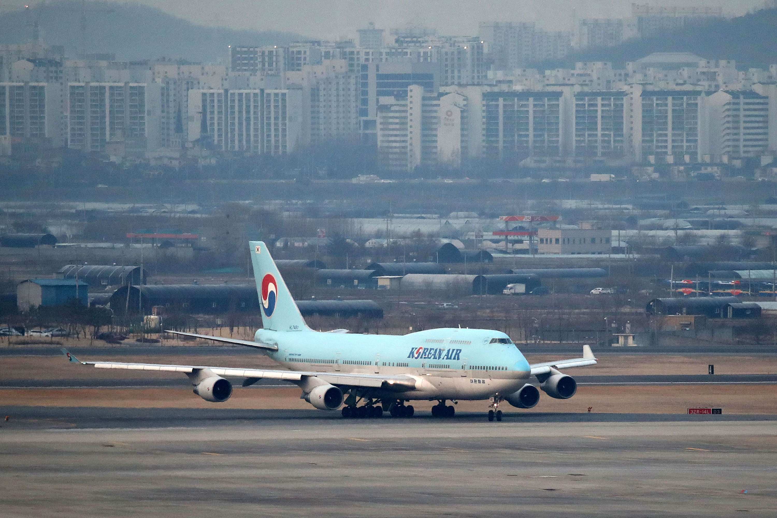 In this file photo, an airplane carrying South Korean citizens repatriated from Wuhan lands in Seoul, South Korea, January 31.