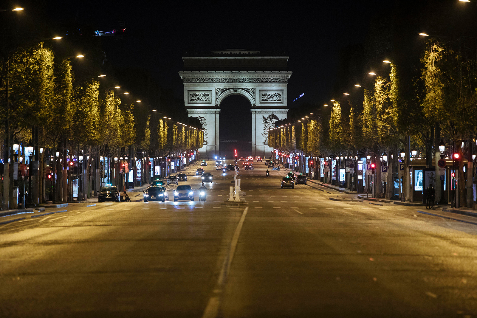 The Champs-Elysees avenue is almost empty during curfew in Paris, on October 17.