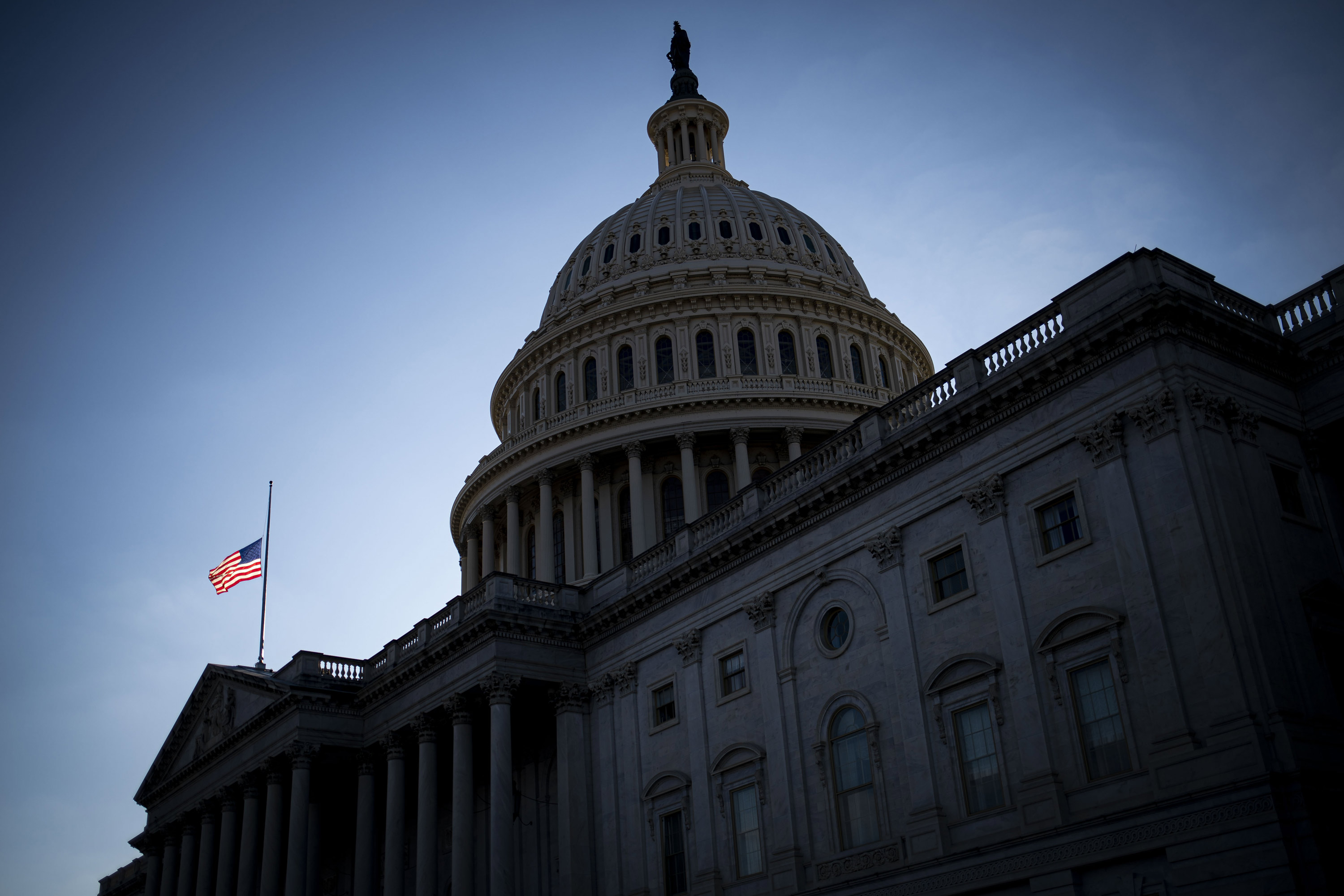 The American flag flies half mast at the U.S. Capitol in Washington, D.C., on December 7.