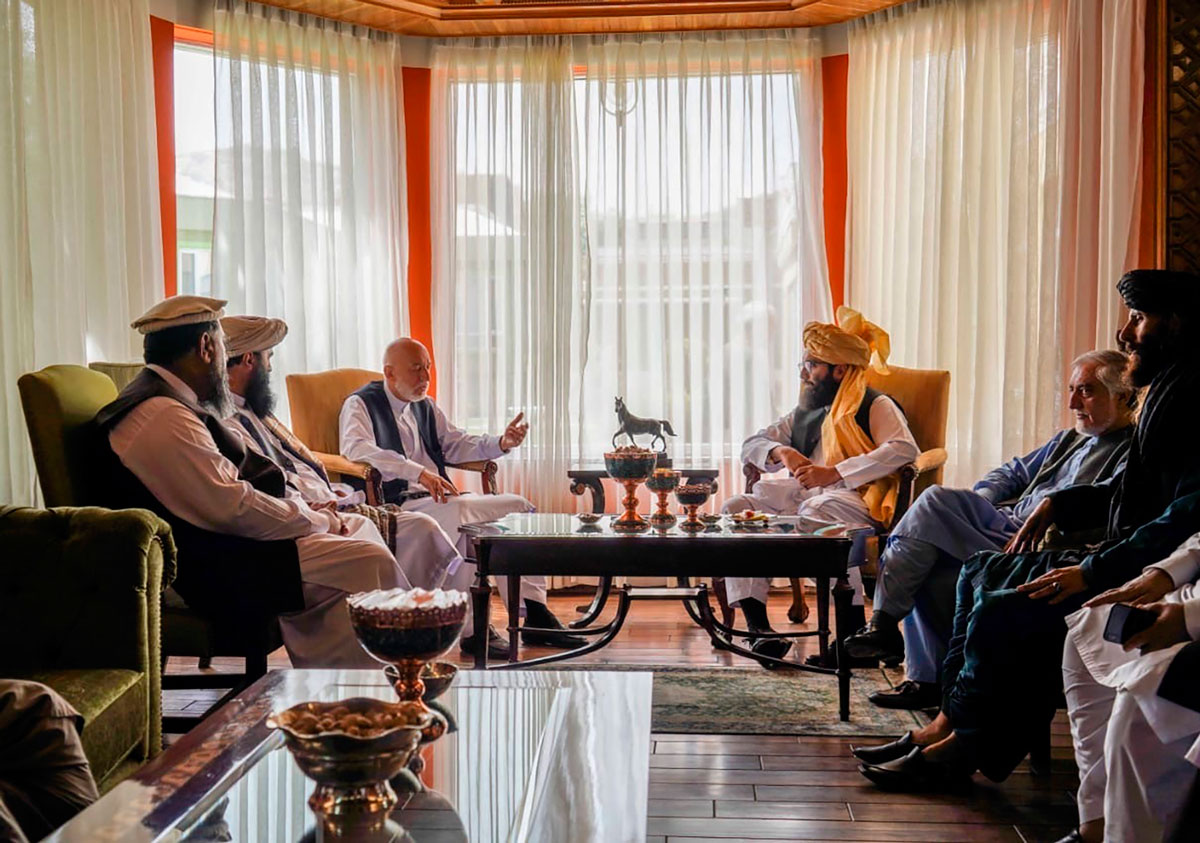 Karzai (center left) meets with senior Haqqani group leader Anas Haqqani (center right) and Abdullah Abdullah (second right) in Kabul on August 18.