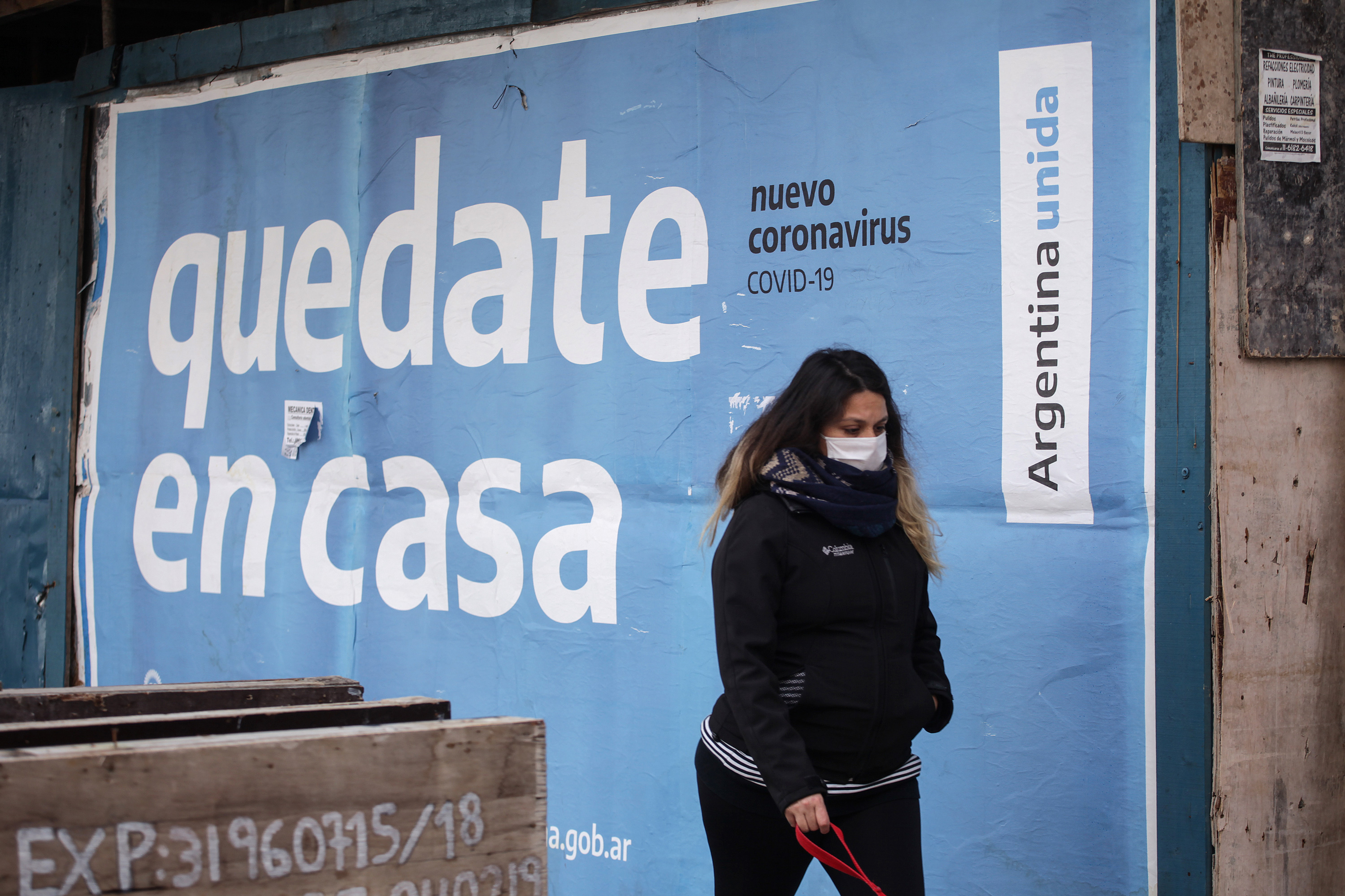 A woman wearing a protective mask walks in Buenos Aires on July 31.