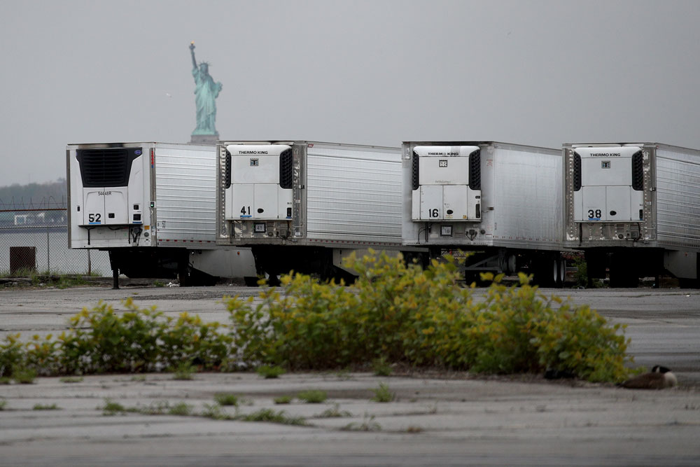 Refrigerated trucks functioning as temporary morgues are seen at the South Brooklyn Marine Terminal on May 6, in New York City.