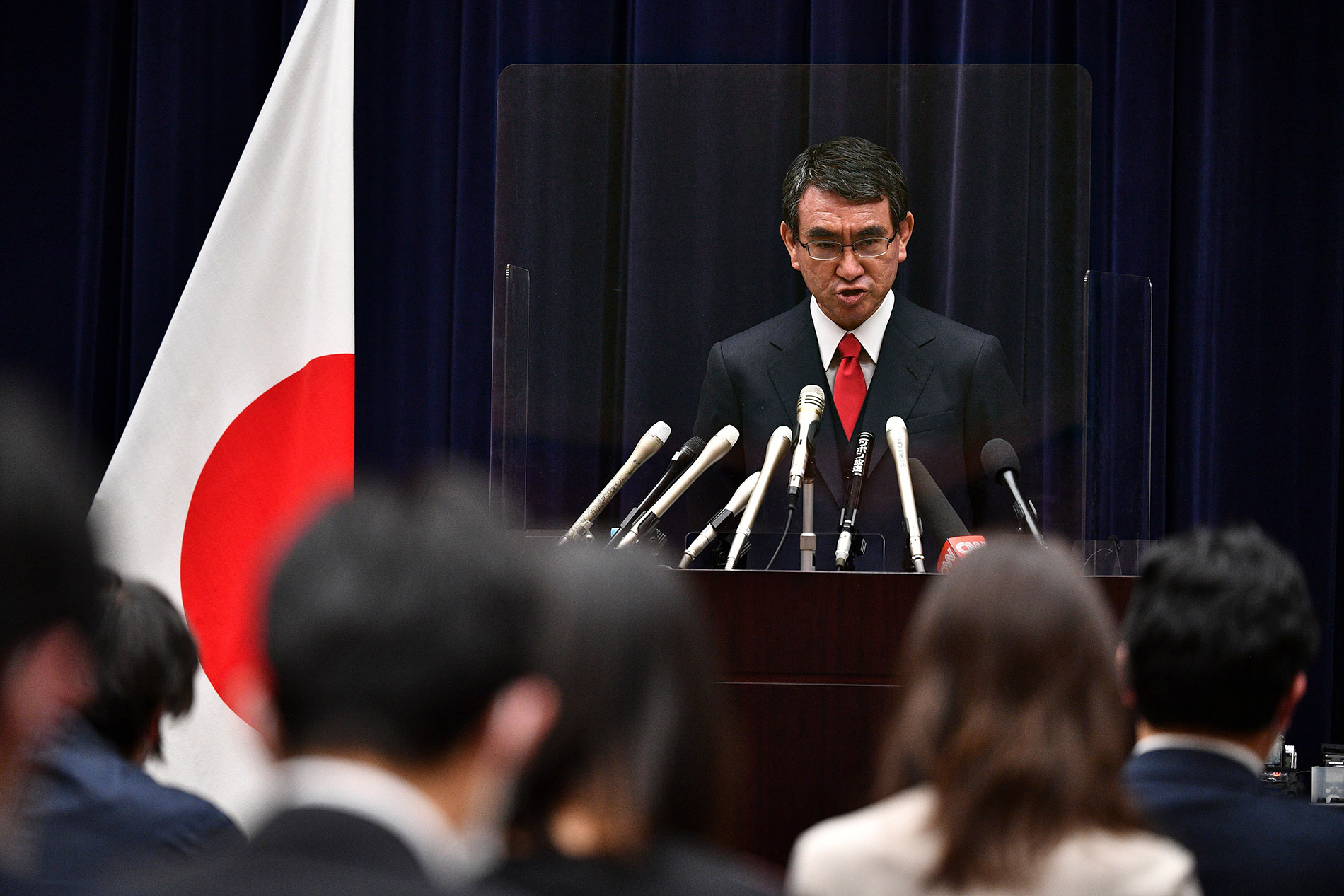 Japan's minister in charge of Covid-19 vaccinations, Taro Kano, speaks during a news conference in Tokyo on February 16, 2021.