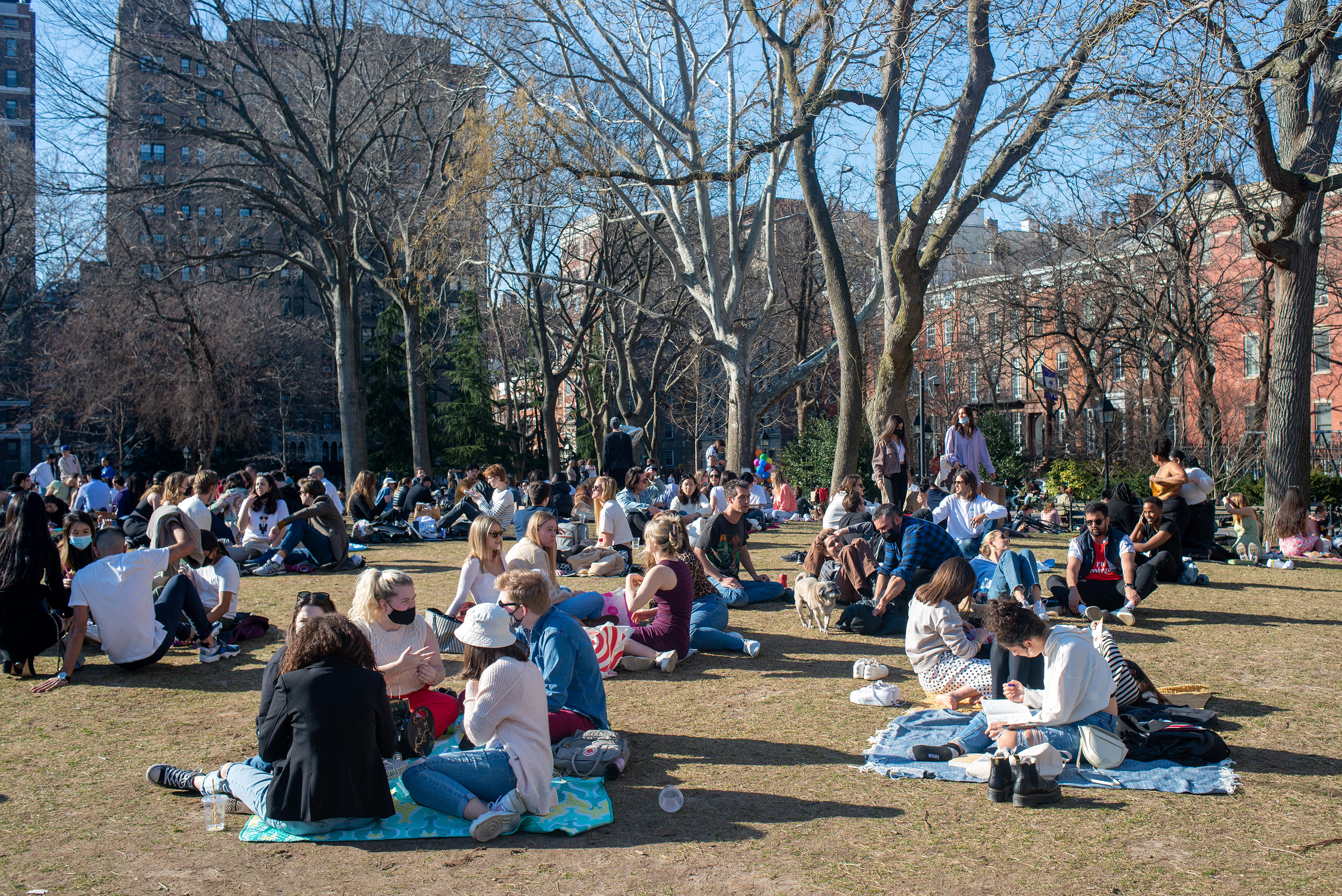 People gather in Washington Square Park on Sunday, March 21, in New York City.