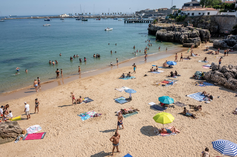 Beachgoers in Praia da Rainha in Cascais, Portugal, on May 29.