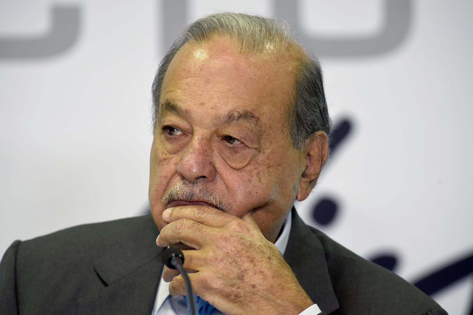 Mexican tycoon Carlos Slim Helú listens to a question during a news conference in Mexico City, on October, 16, 2019.