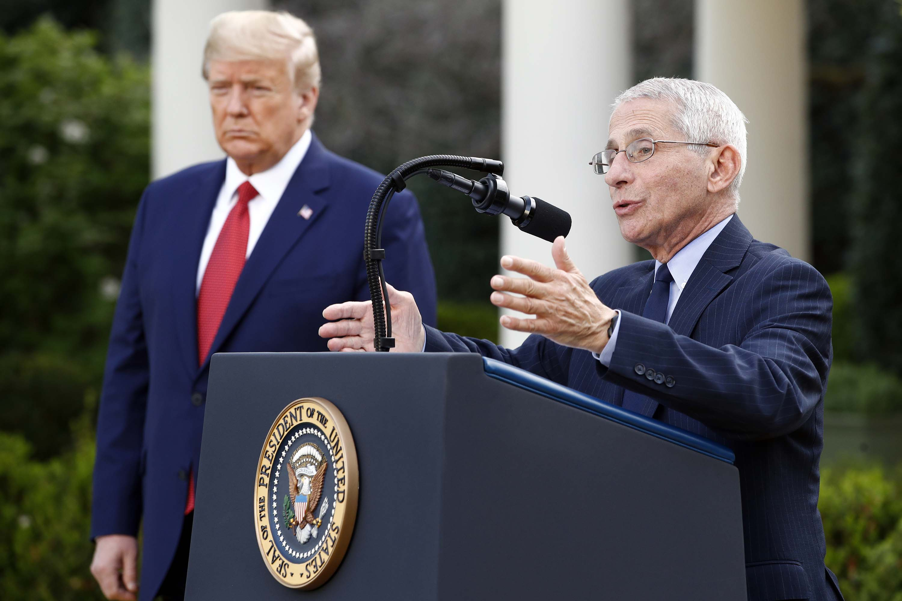 President Donald Trump listens as Dr. Anthony Fauci, director of the National Institute of Allergy and Infectious Diseases, speaks during a coronavirus task force briefing at the White House on March 29.